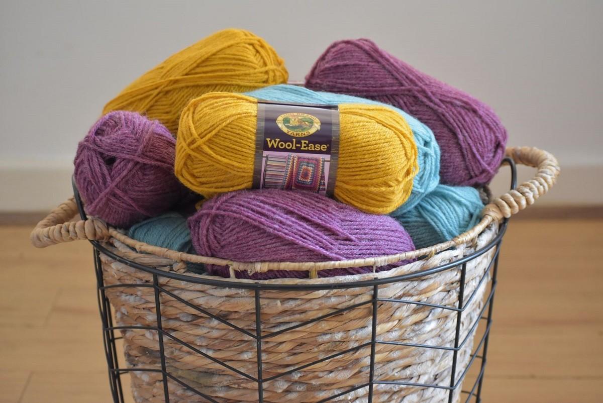 Lion brand wool-ease yarn skeins in basket