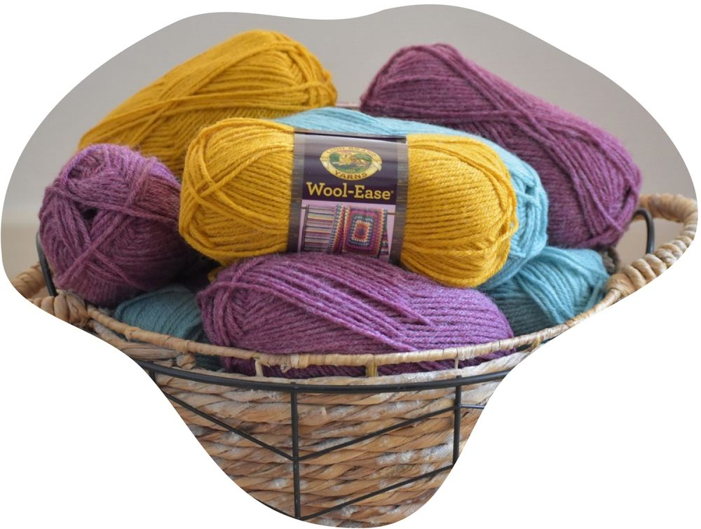 Lion brand wool-ease yarn skeins in basket