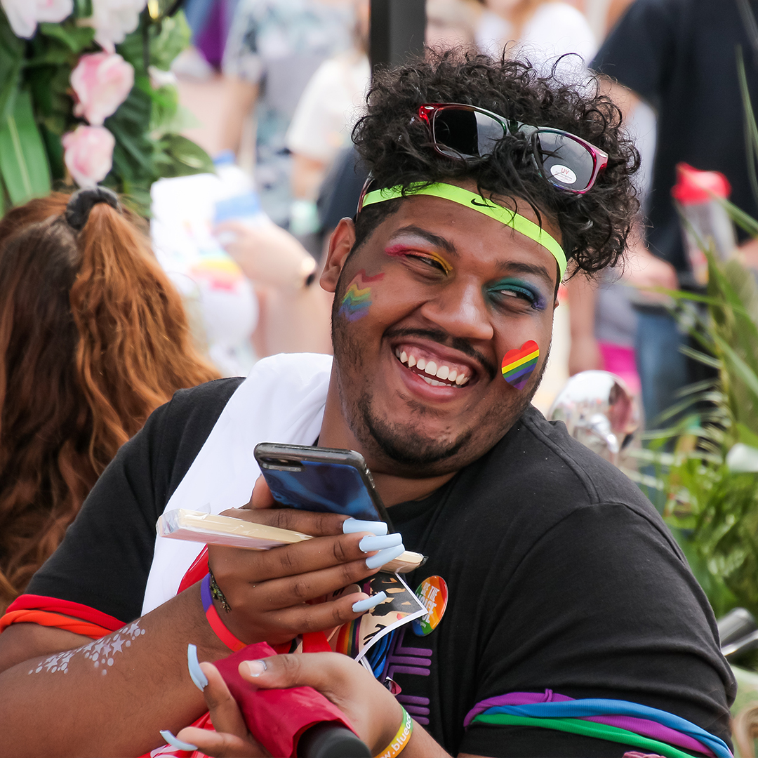 Pride parade attendee in brand booth at Columbus Pride