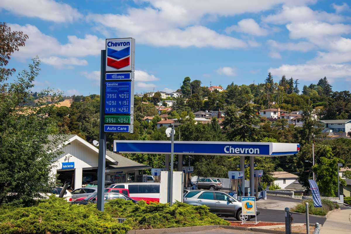 A complete gas station overhaul with canopy signage and gas pricer pylon signage for Chevron