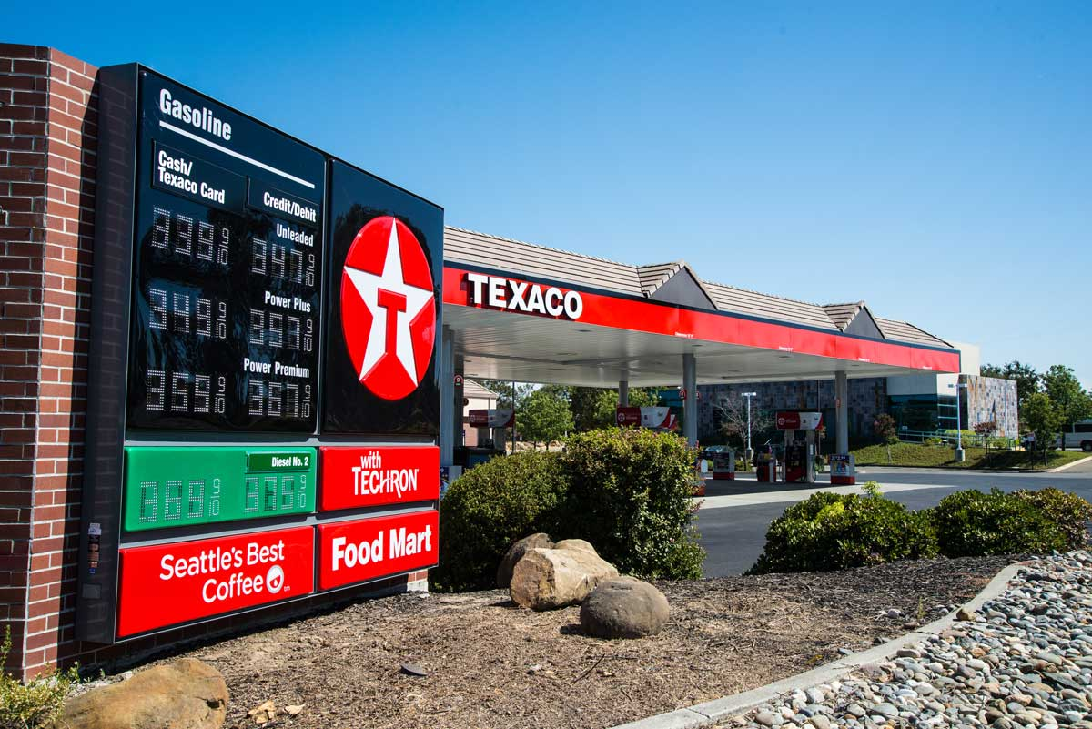 A complete gas station overhaul with canopy signage and gas pricer monumental signage for Texaco
