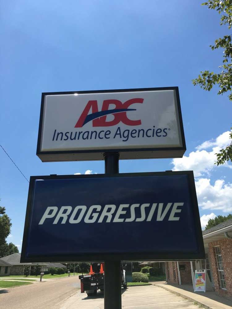 A pylon sign with thermoformed faces for ABC Insurance and Progressive
