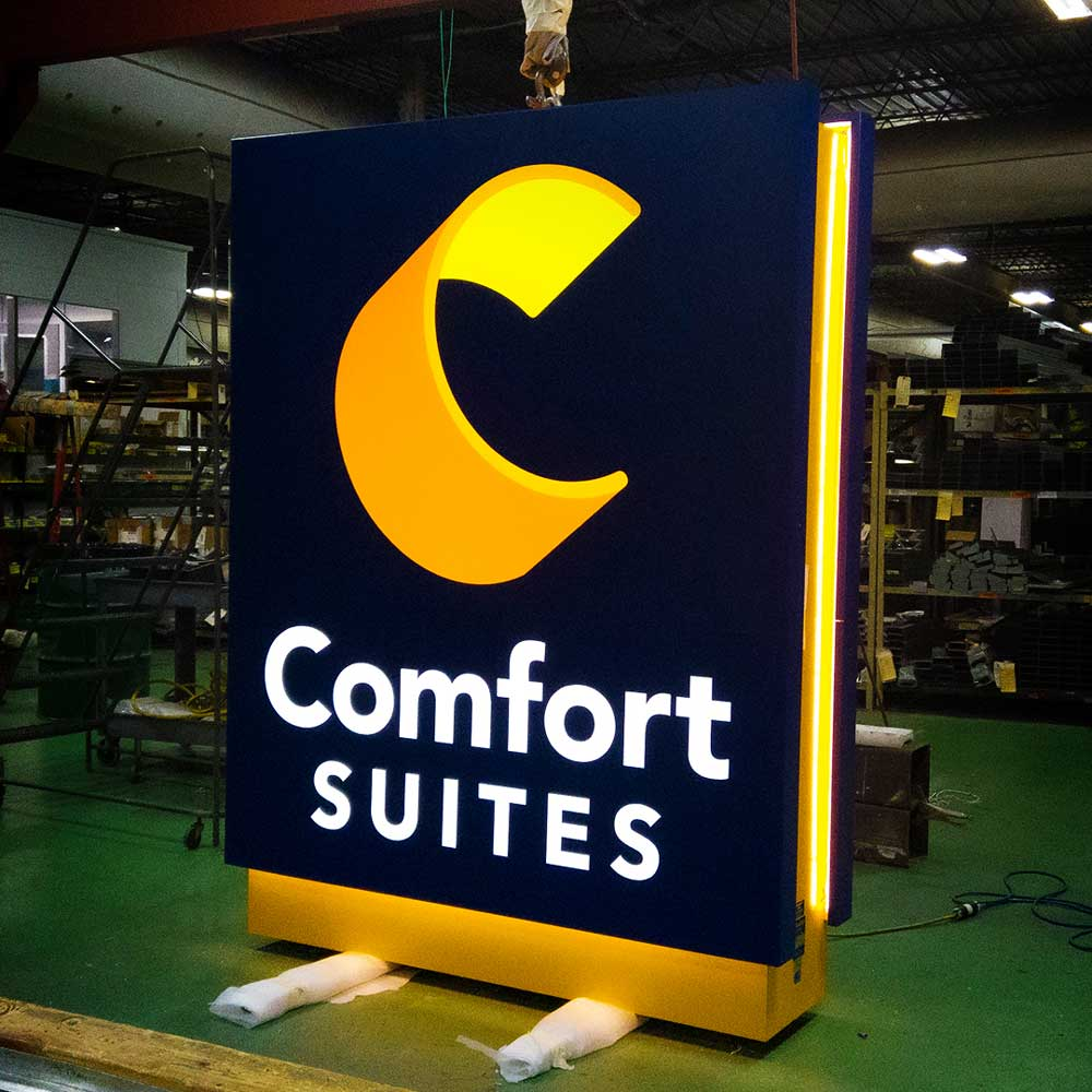 A freshly completed Comfort Suites monument sign with special lighting effects