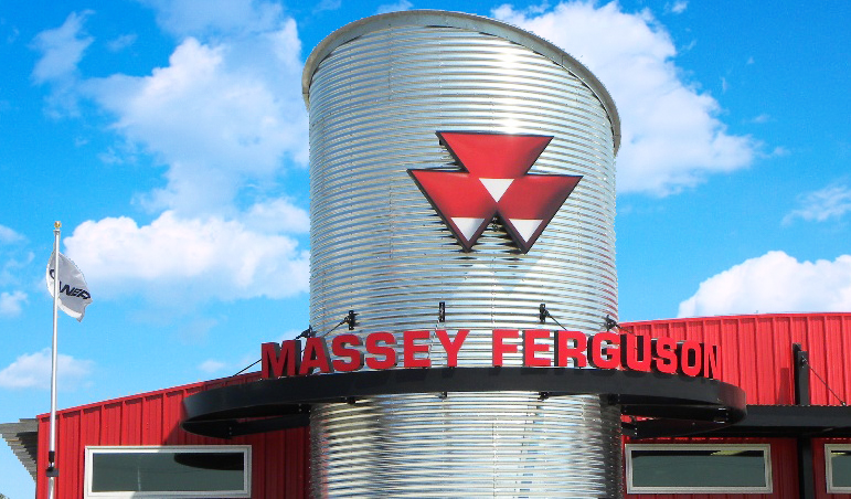A unique custom cut logo sign and channel letter signs mounted to a Massey Ferguson store silo