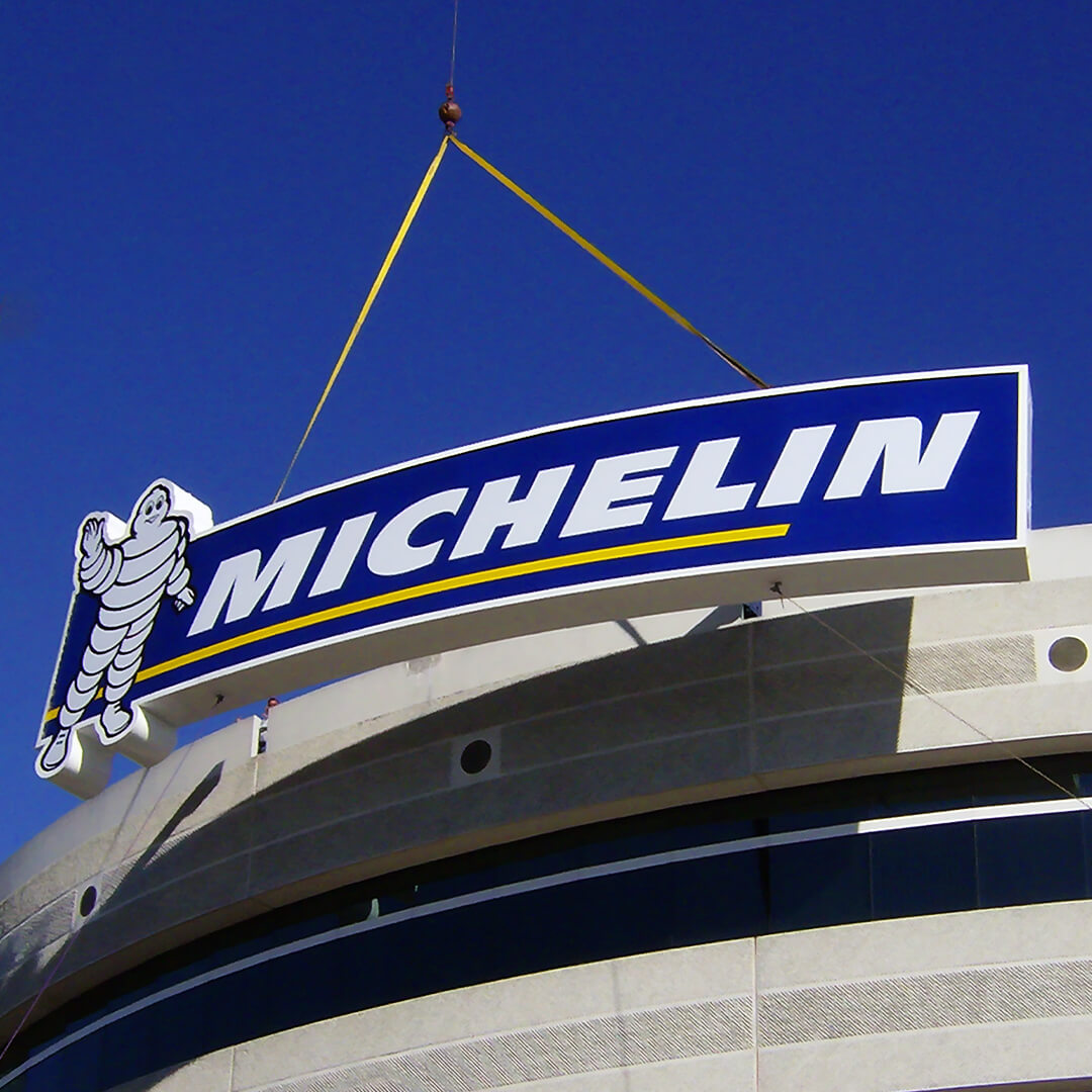 Large curved flexface Michelin sign installed at their Headquarters