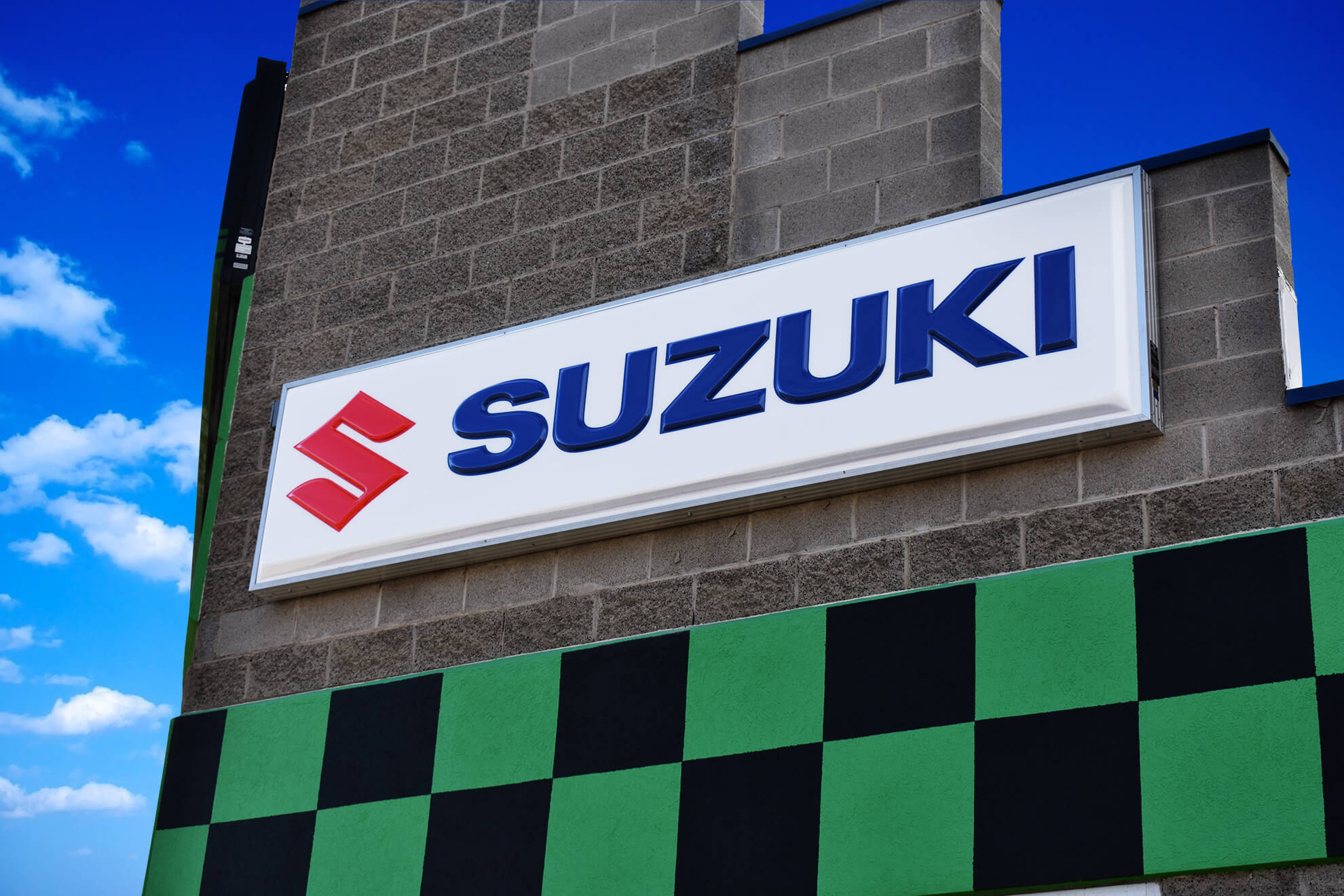 Thermoformed Suzuki sign.