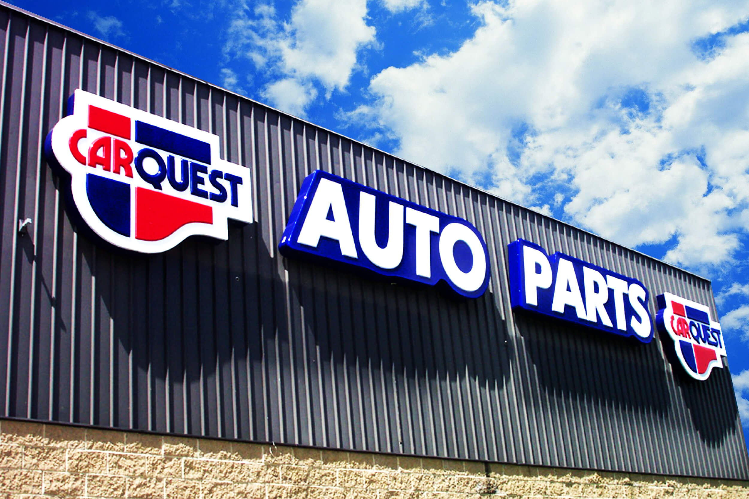 This large cloud/contour CarQuest signage spanned across the width of this store helps this minimalistic building style stand out.