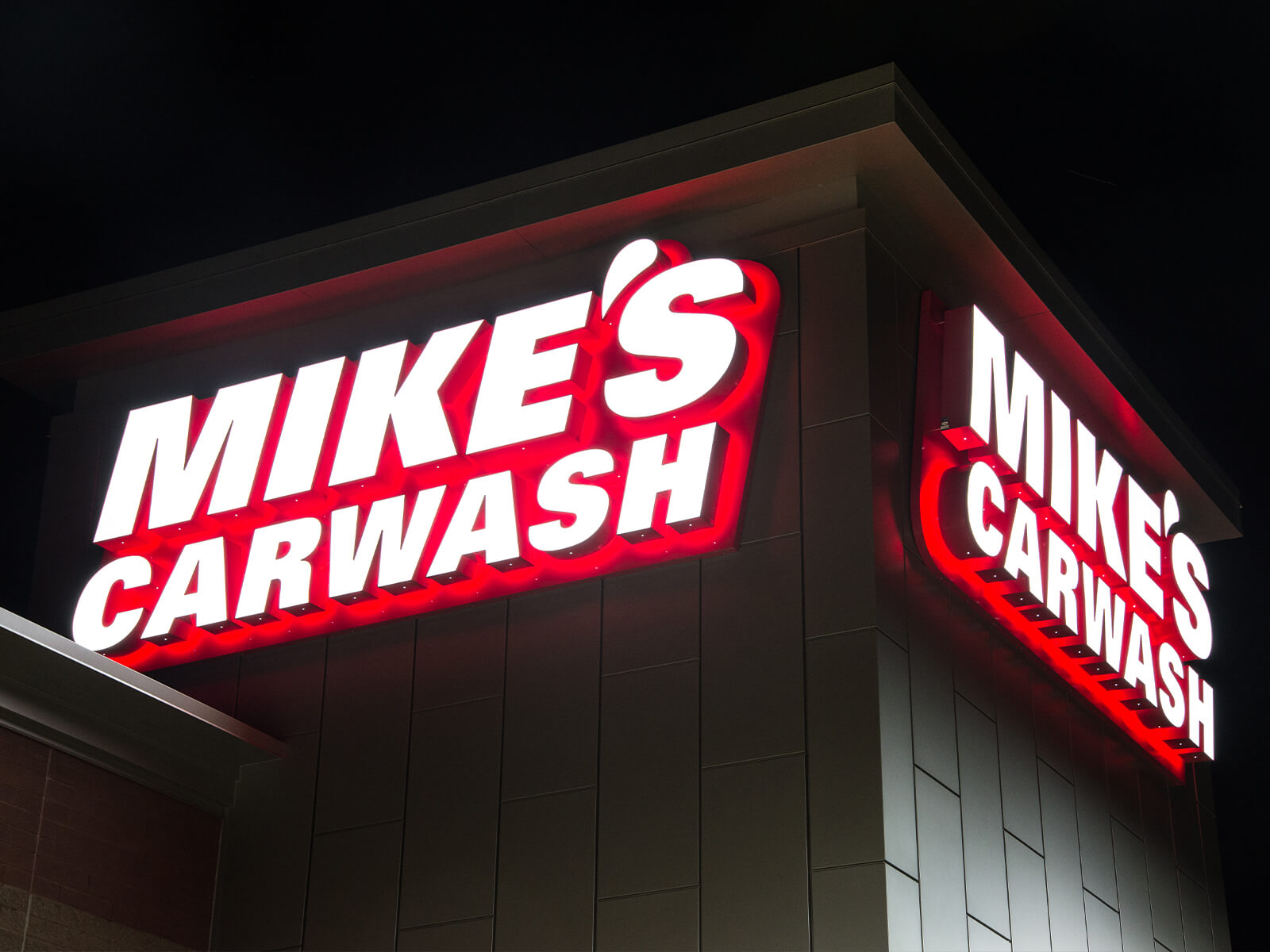 One of many Mike's Carwash locations we've done complete signage packages for using creative fabrication techniques to give this sign an awesome glow at night time.