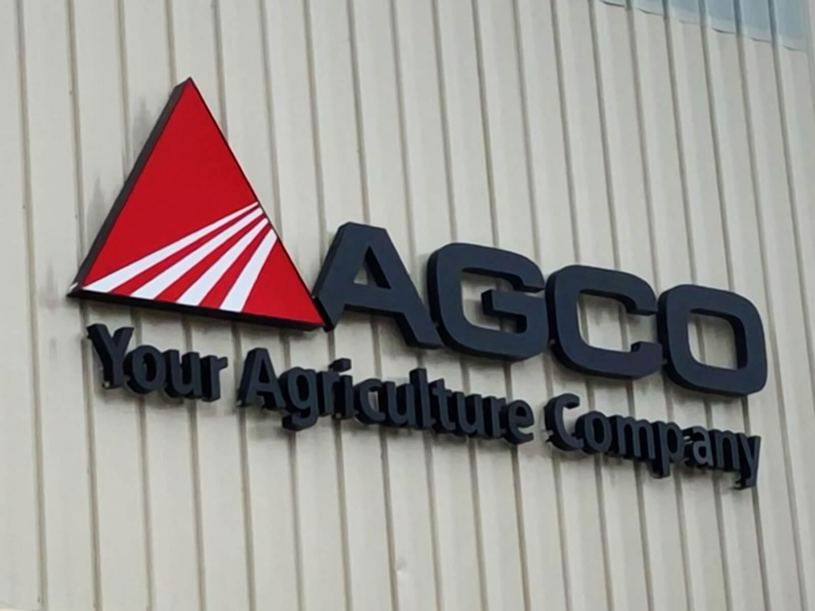 Low profile signage for an AGCO business.