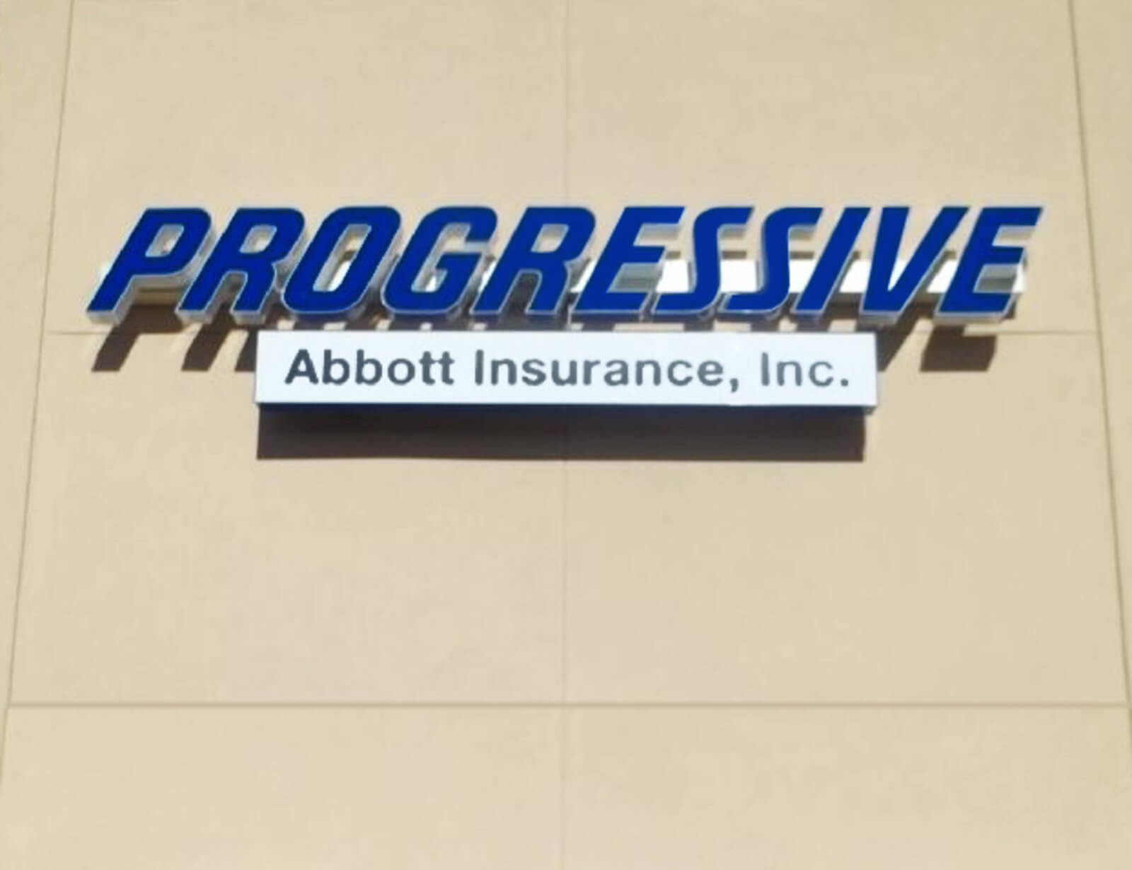 Progressive insurance channel letter sign with custom franchise names.