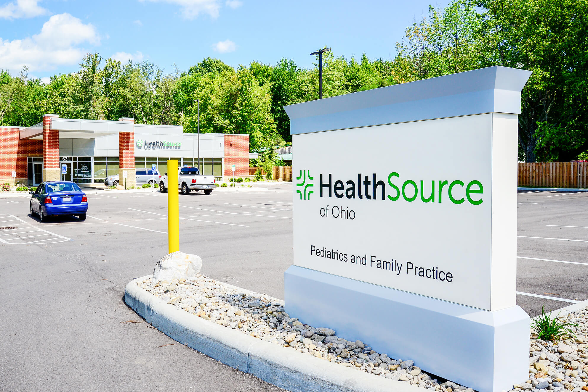 Signage package featuring channel letters, low profile letters, and a monument sign for HealthSource of Ohio.