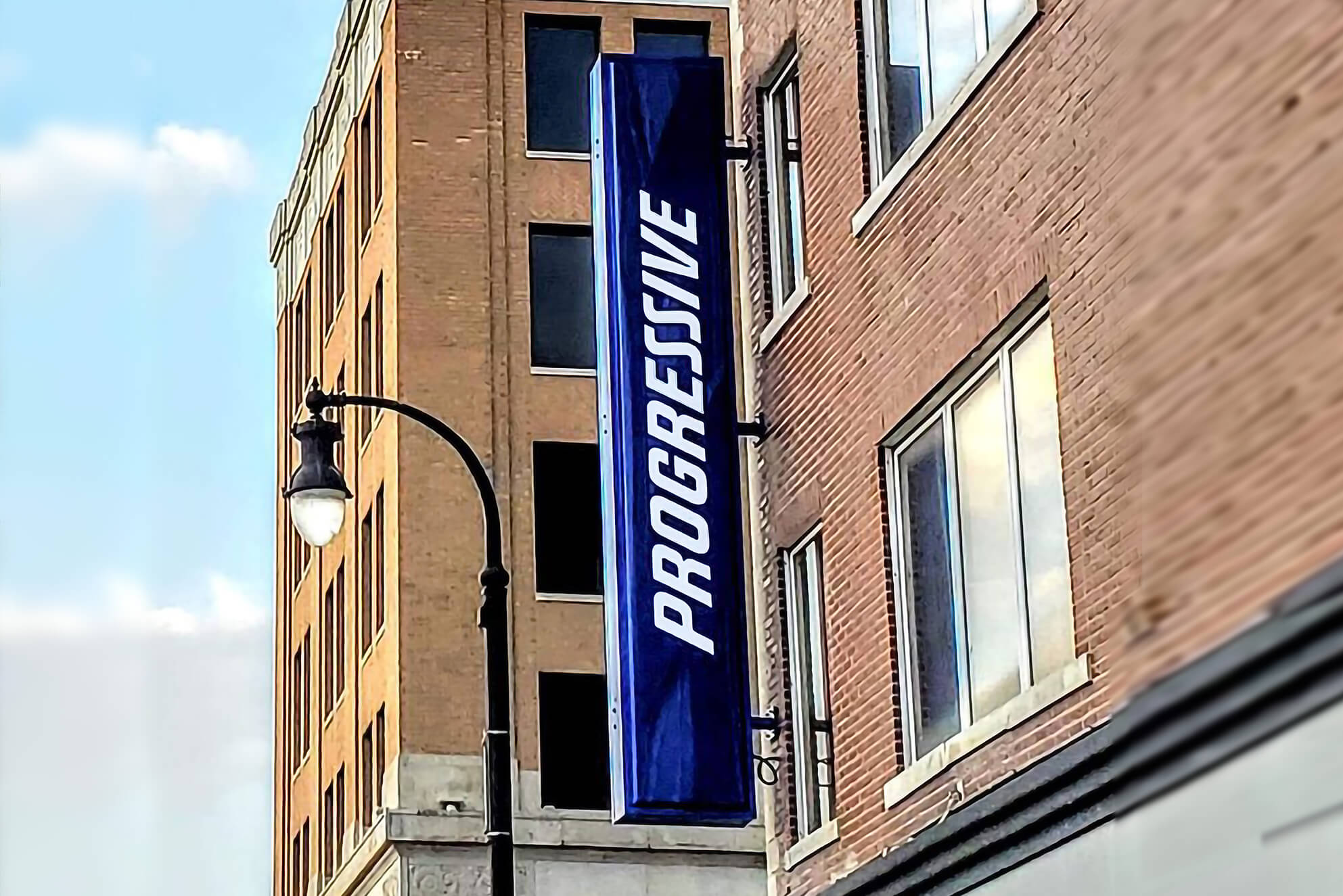 A flagmount sign installed for Progressive.