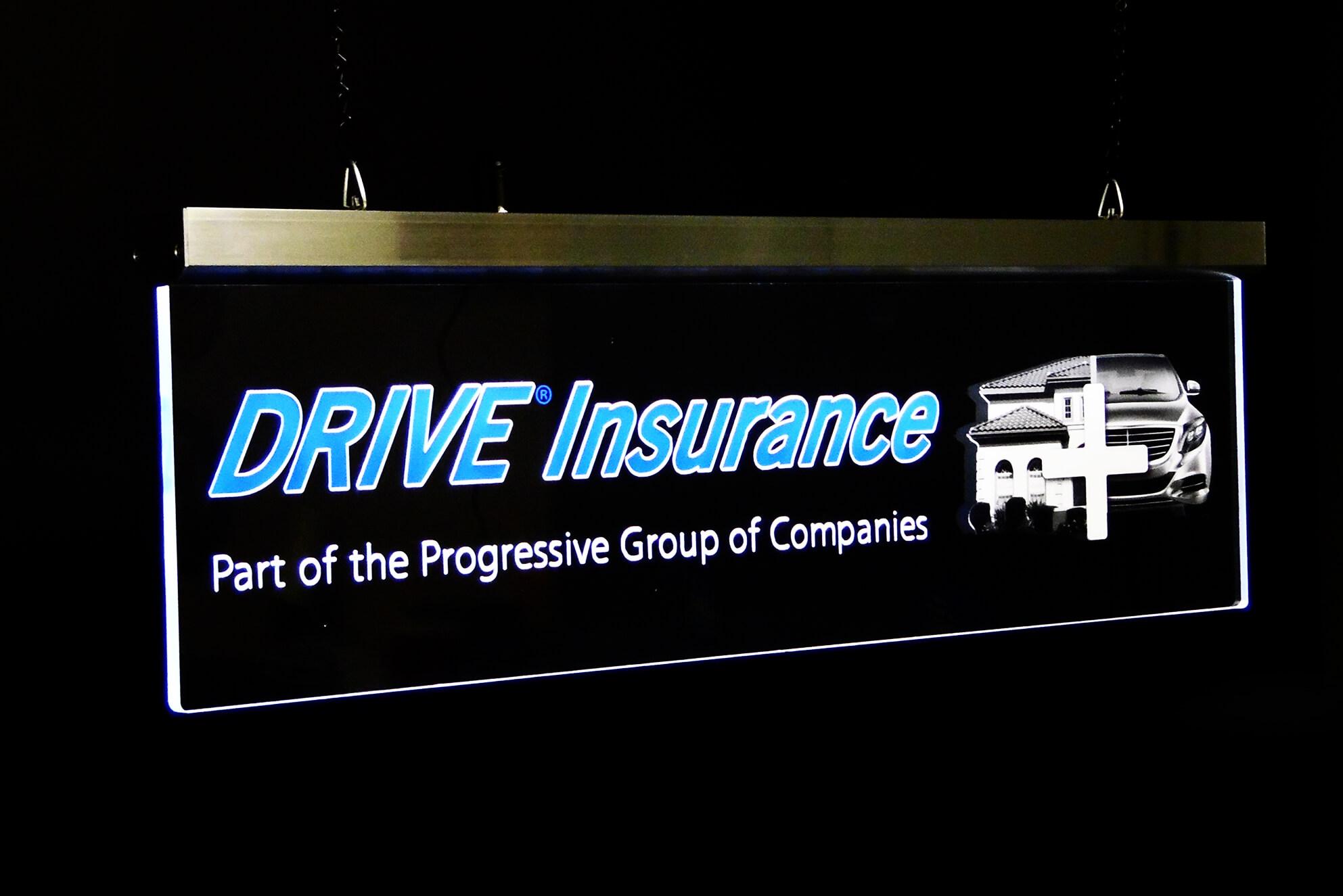 A transparent indoor sign made for Progressive using LED lighting.