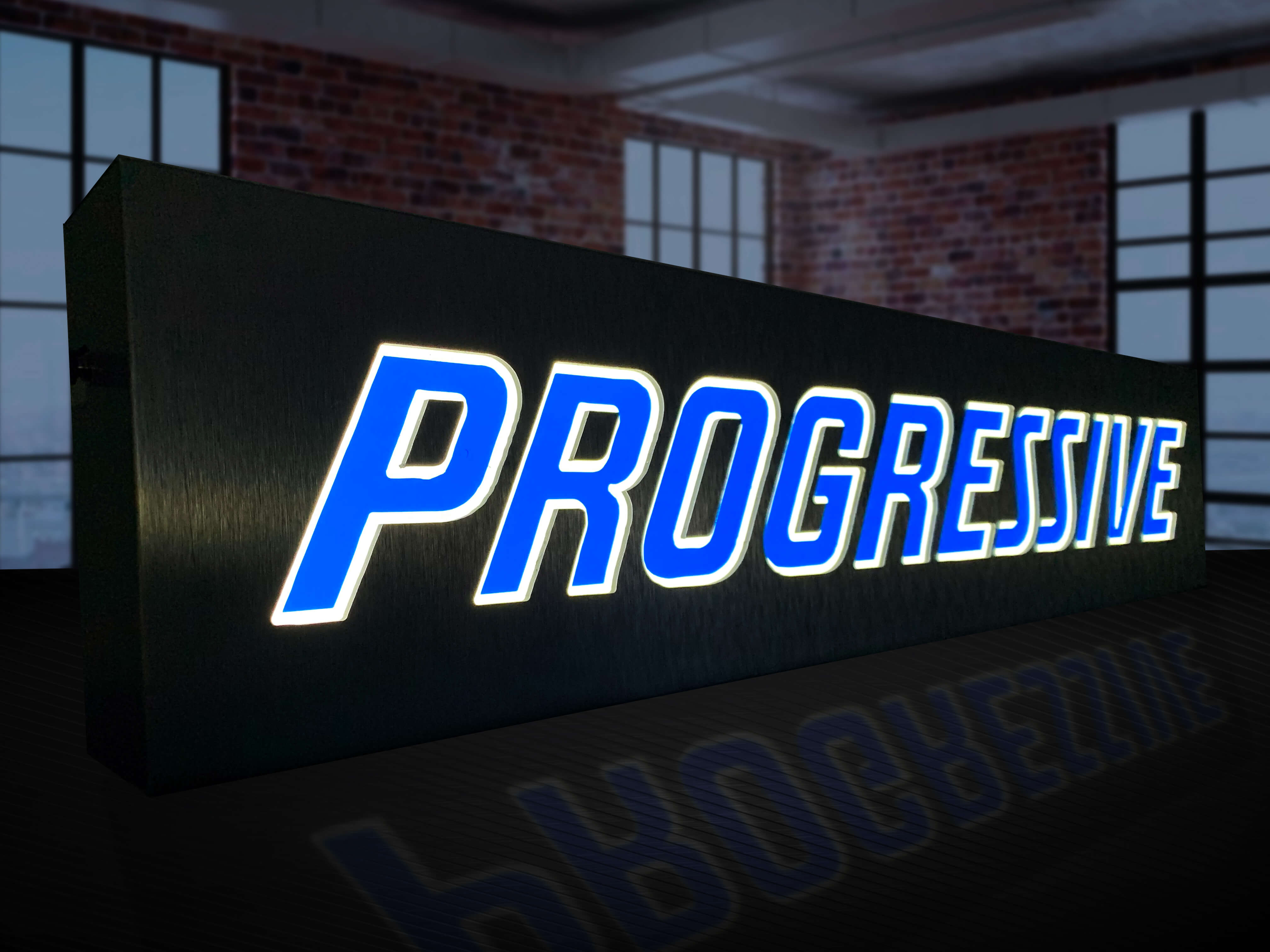 One of several indoor illuminated sign fabricated with aluminum and vinyl for Progressive agencies to display in their spaces.