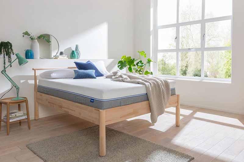Tweak Nrem Mattress on a bed in a bedroom