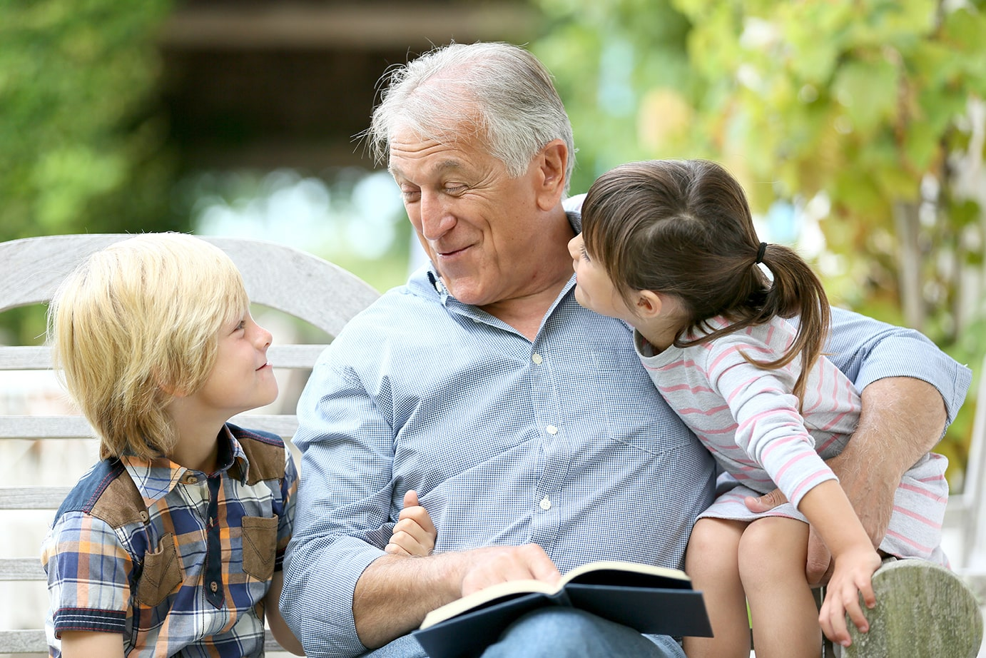 grandfather spending quality time with grandchildren