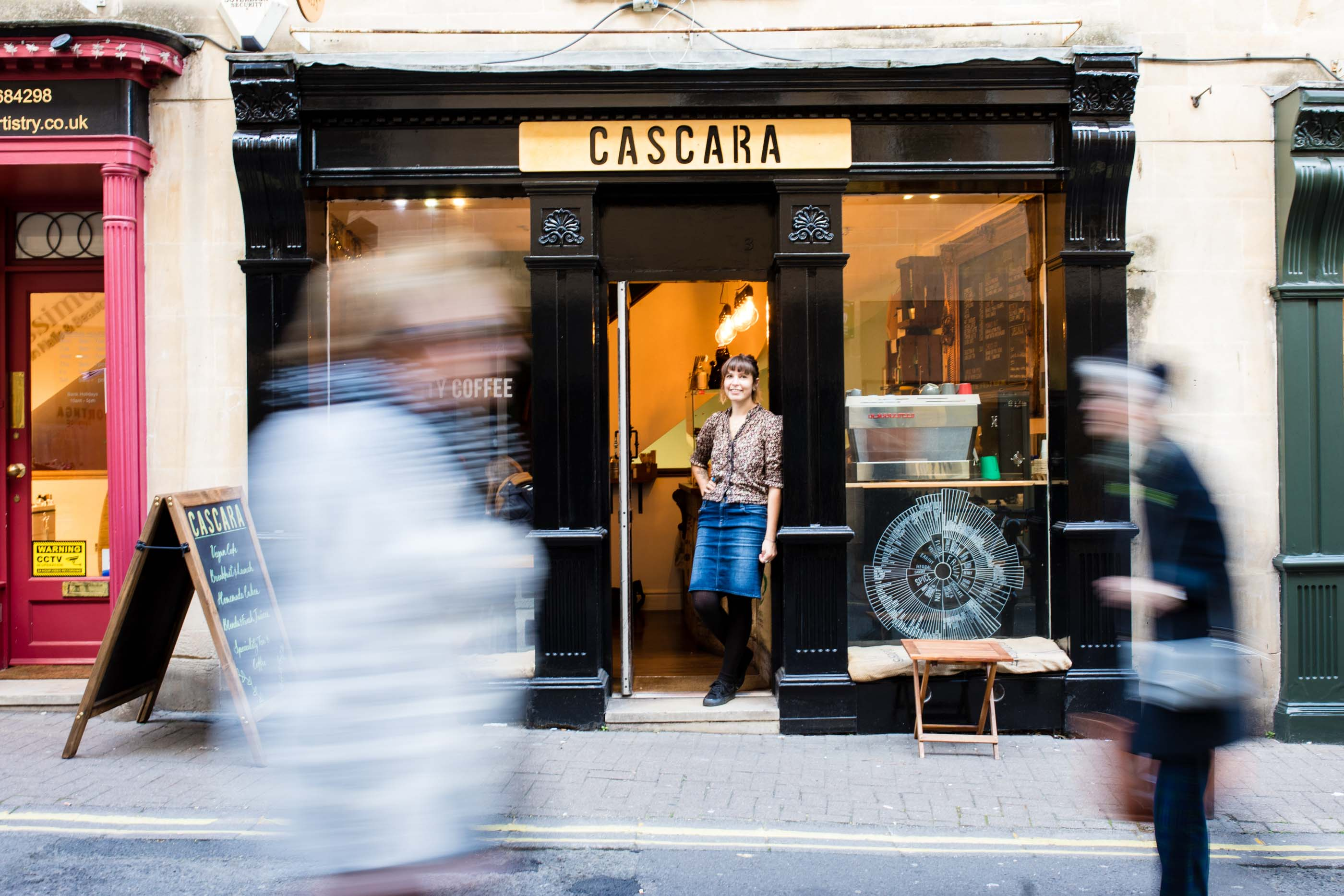 Sus, Owner of Cascara, Bath, standing outside her coffee shop