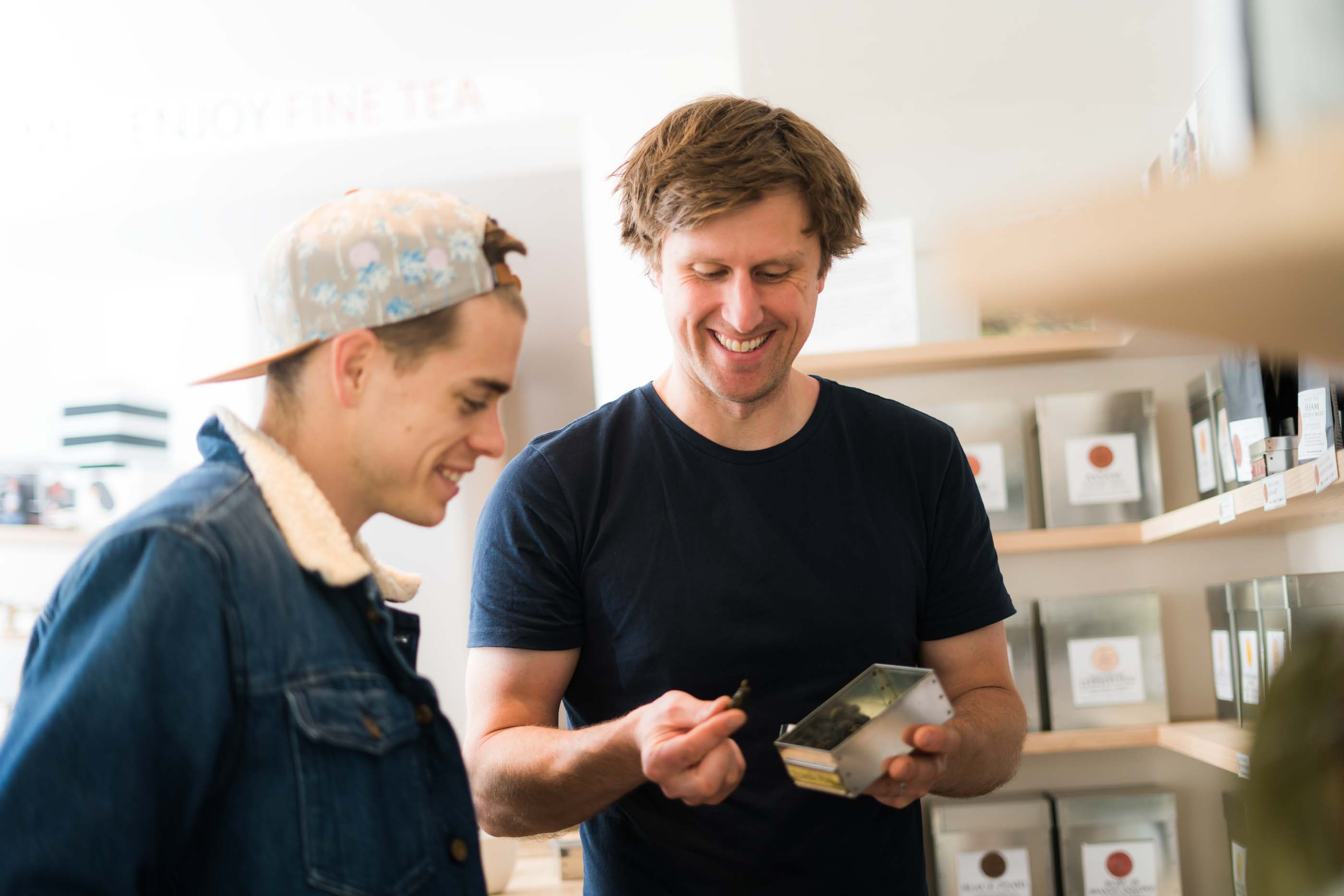 A Pixie business owner showing a product to a customer.