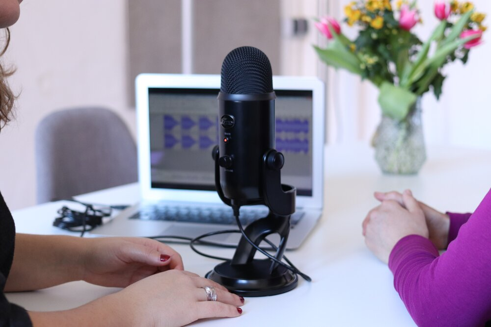 Podcast host speaking into a microphone