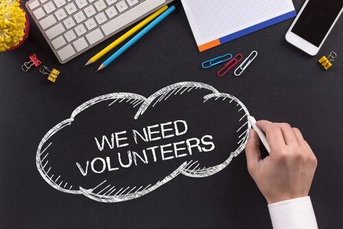 An advertisement for more volunteers