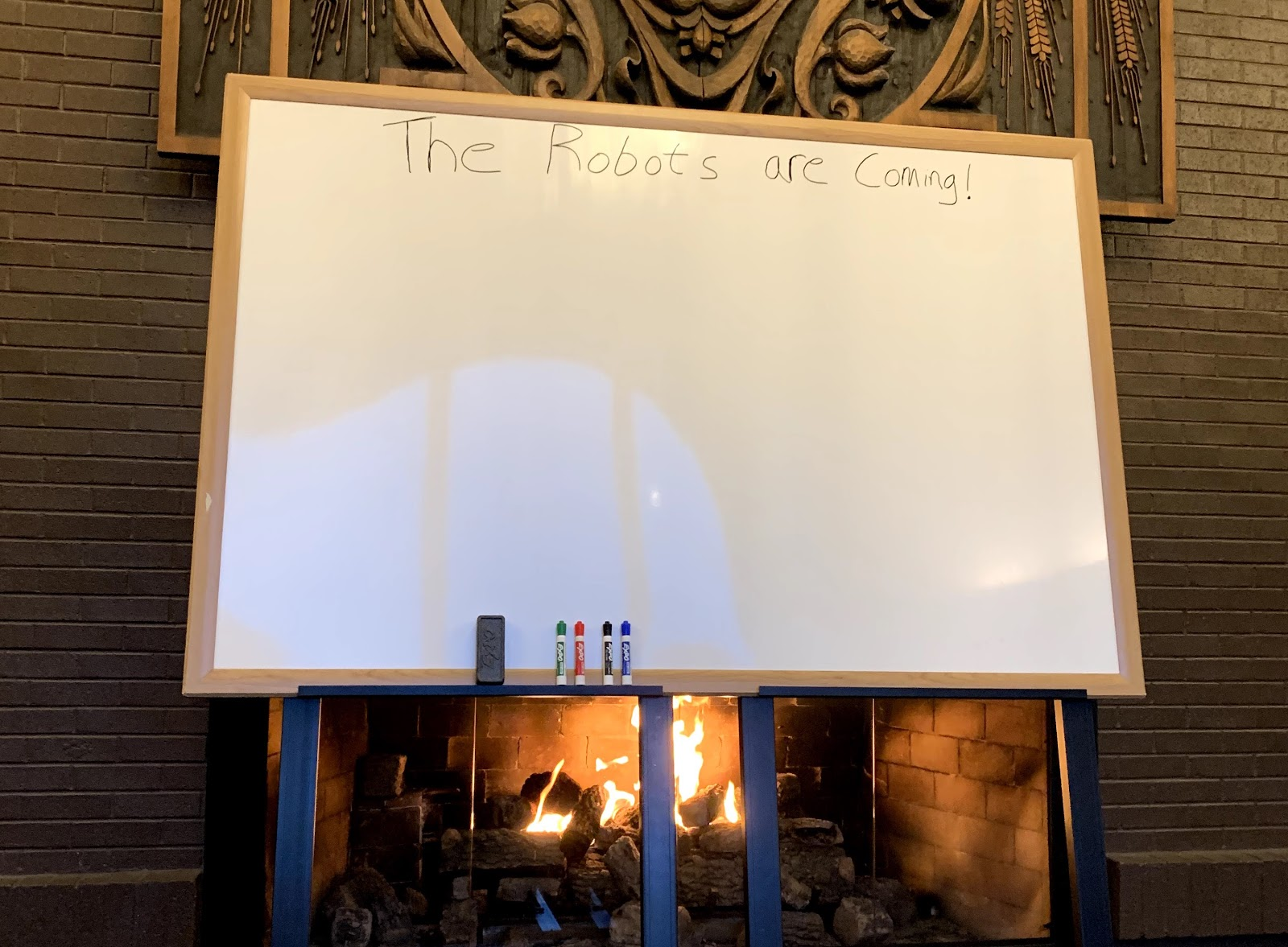 A white board in front of a fireplace during a HR professionals retreat