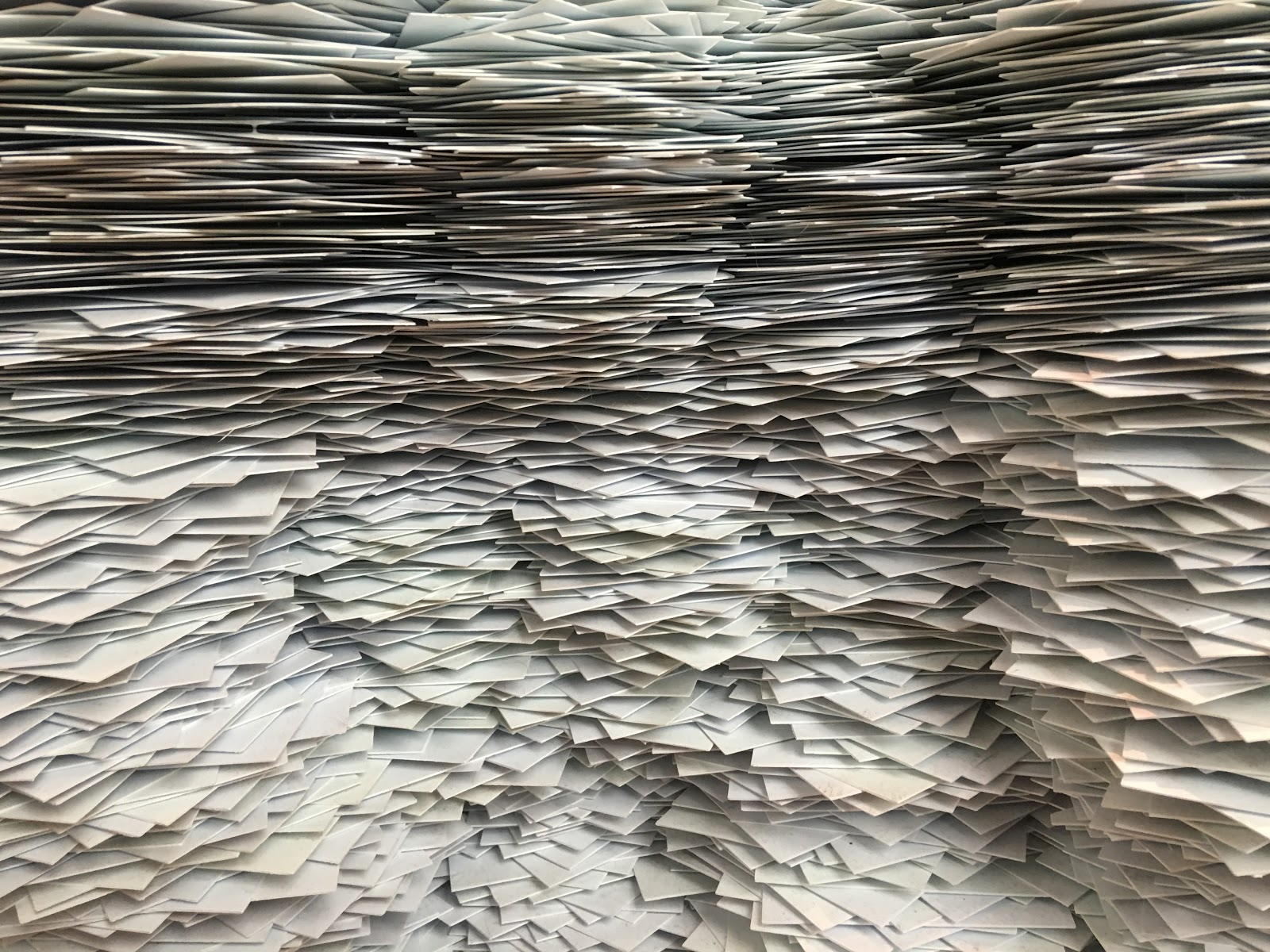 A clutter of paperwork filling a room