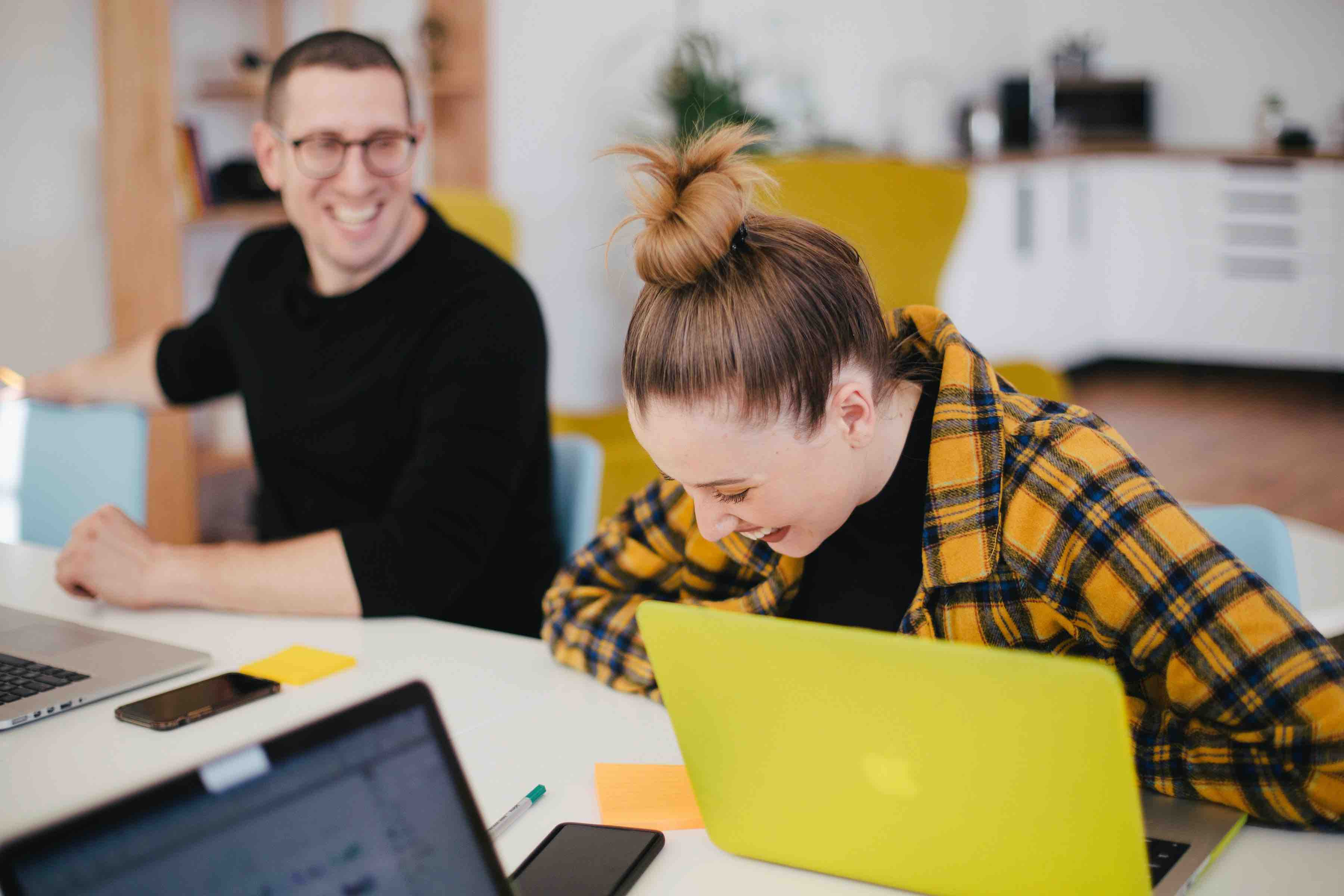 Employees happily engaging with each other