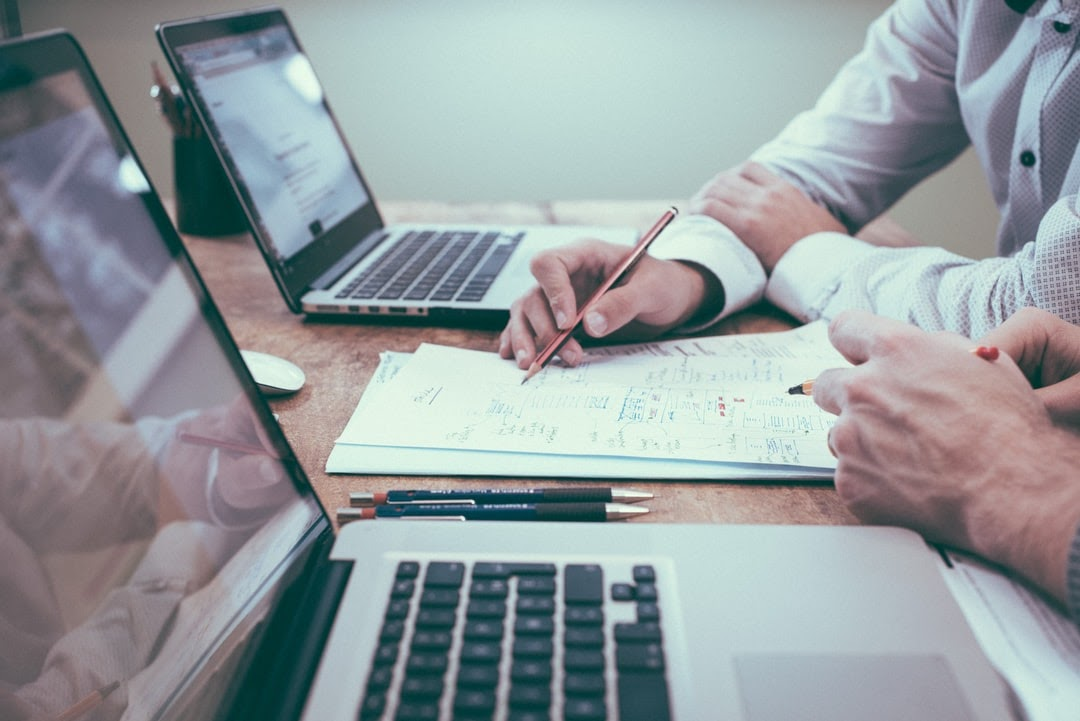 HR professionals assessing HRIS