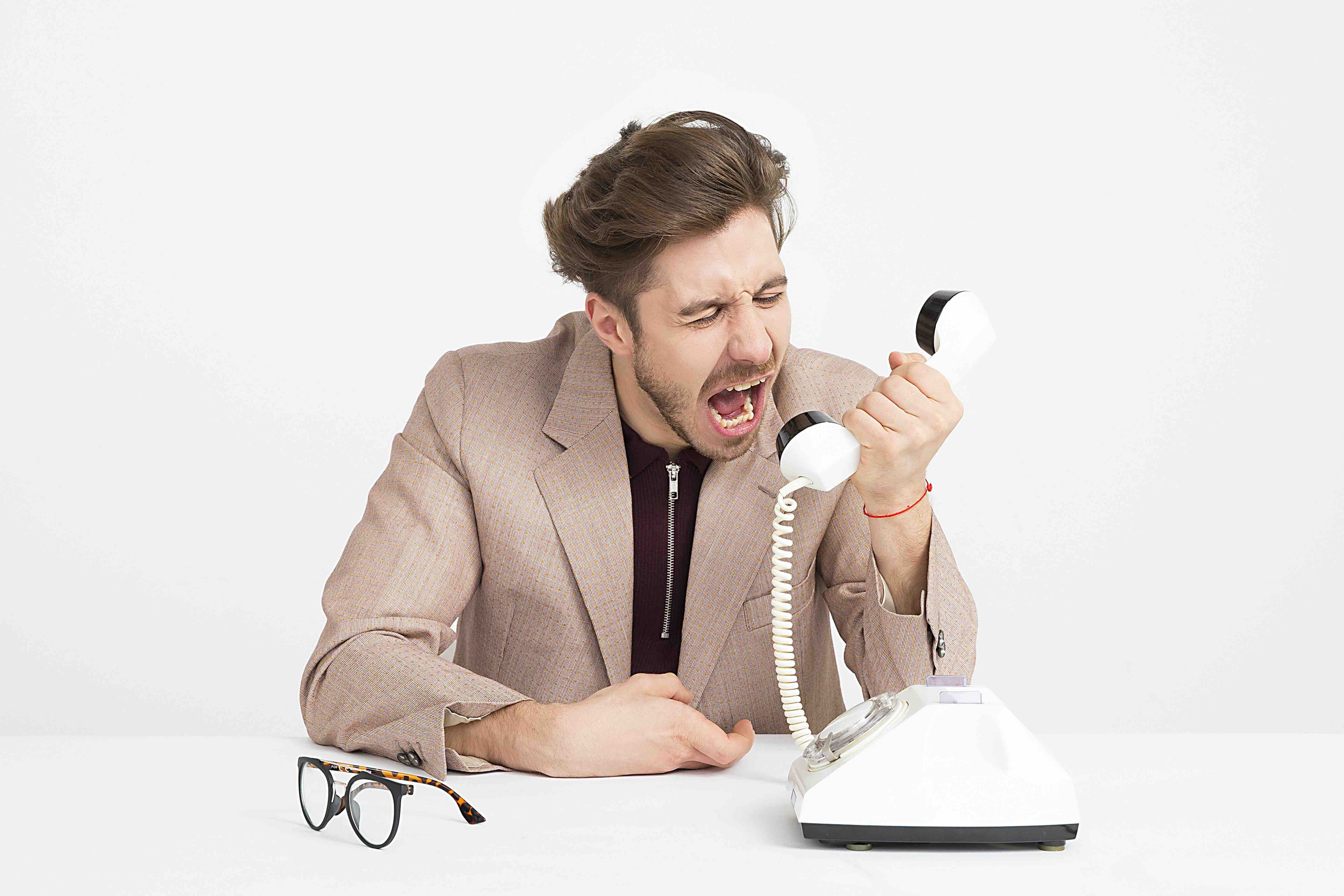 Employee yelling through the phone