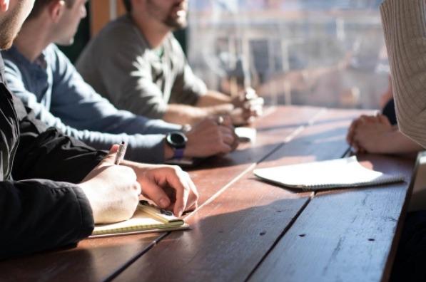 HR professionals planning their performance management program