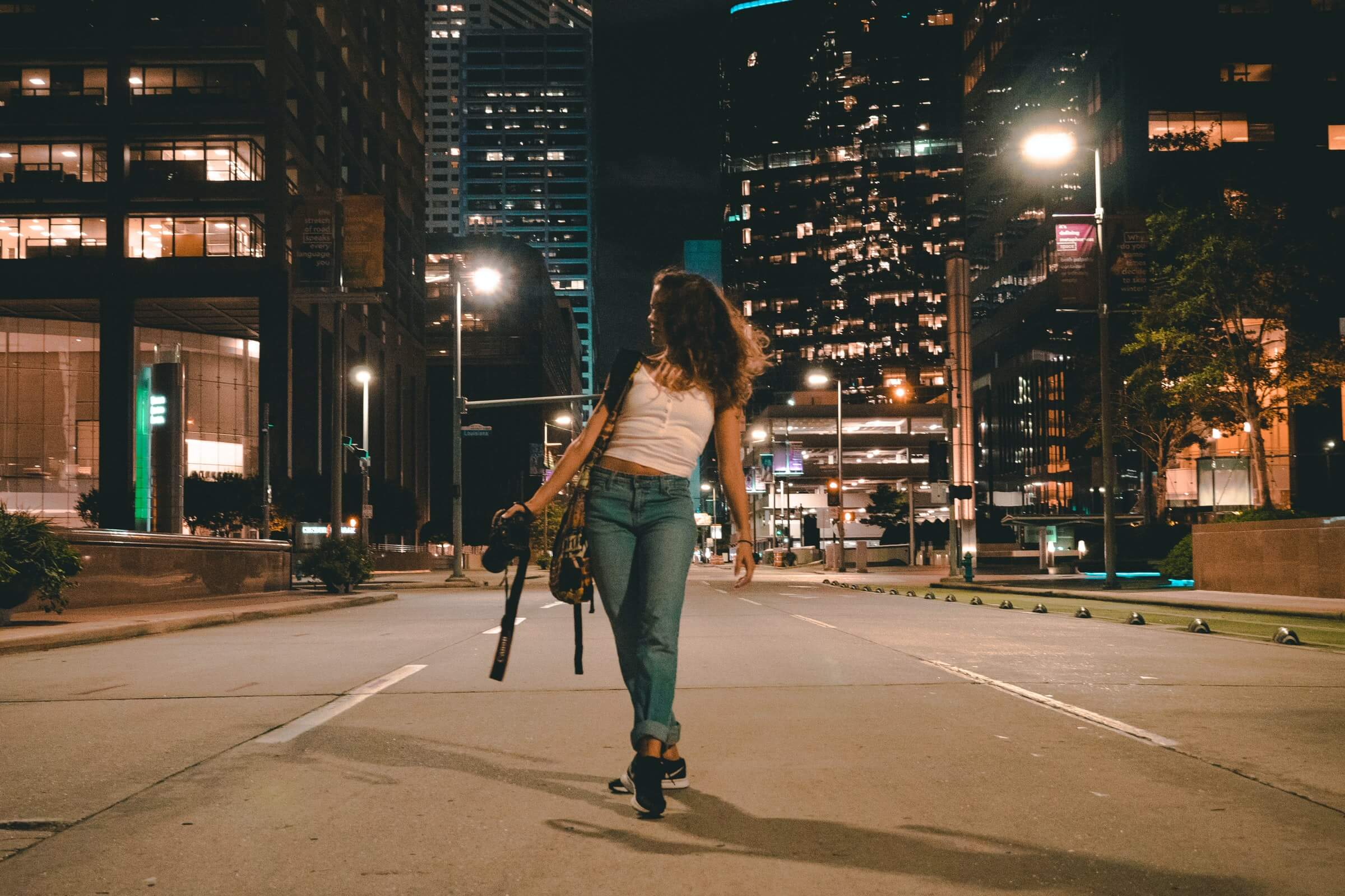 "Girls walks down the empty streets of Houston, illustrating the population loss outlined in Unacast's white paper, ""Houston's billion dollar break up"""