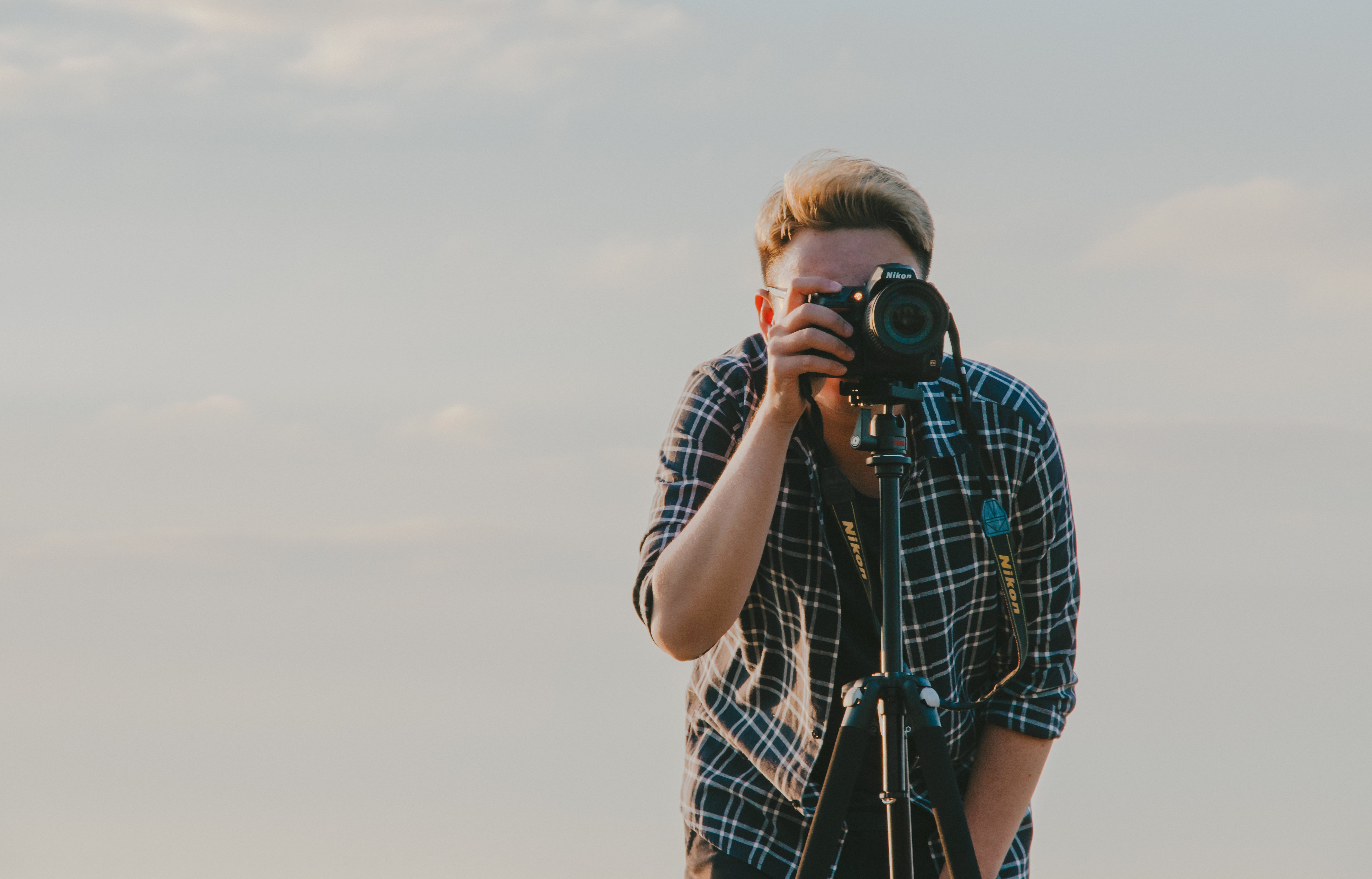 Canva - Man Holding Dslr Camera With Tripod