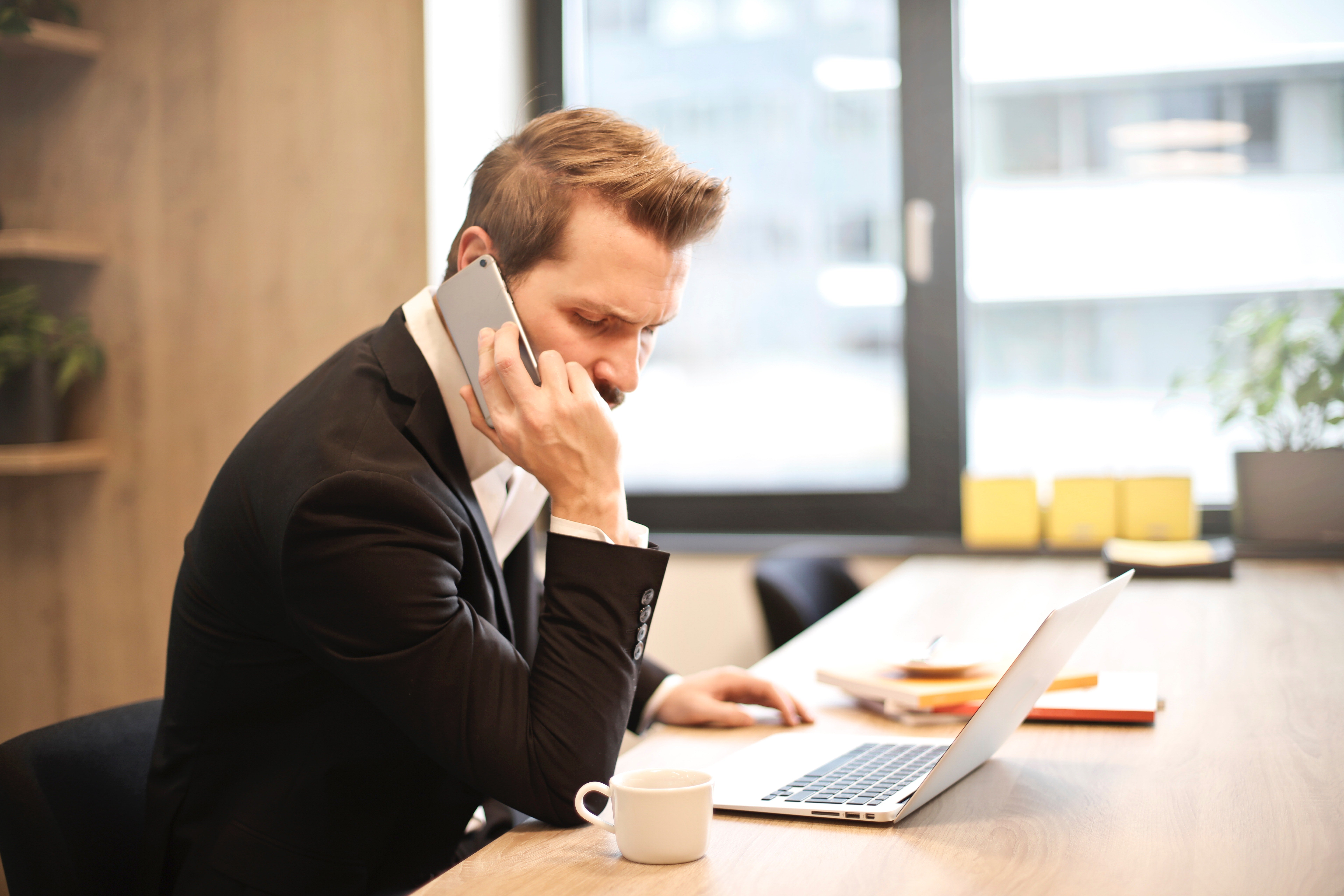 Entrepreneur following up with a prospect on his cell phone