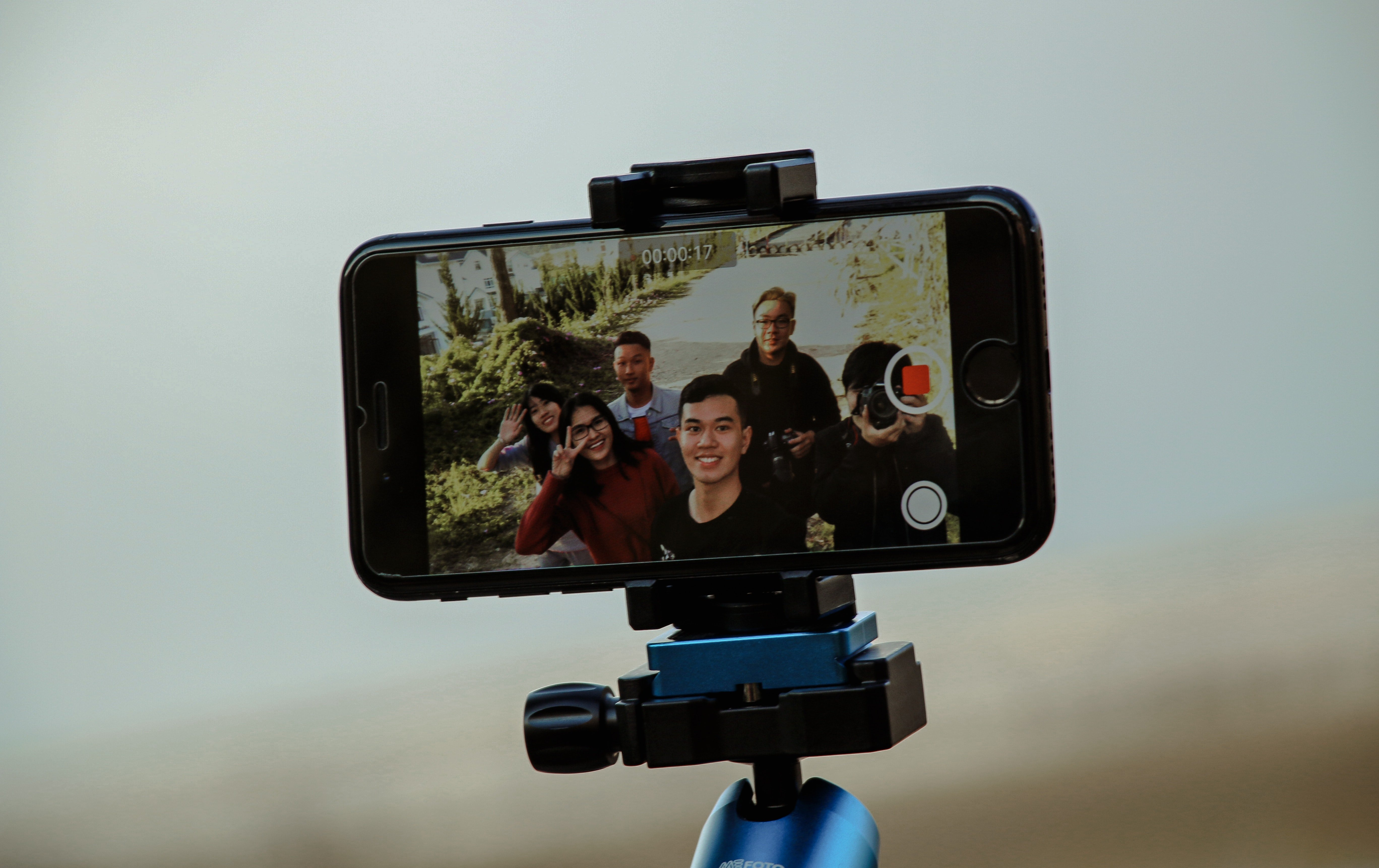 A person taking a video on their smartphone.