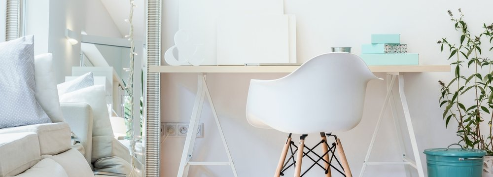 Panorama of contemporary study area with simple wooden desk