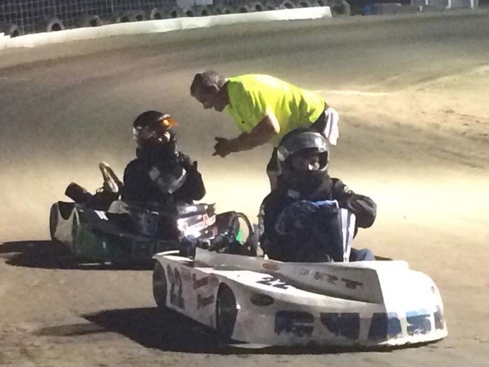 Doug coaching Breanna in a flat kart