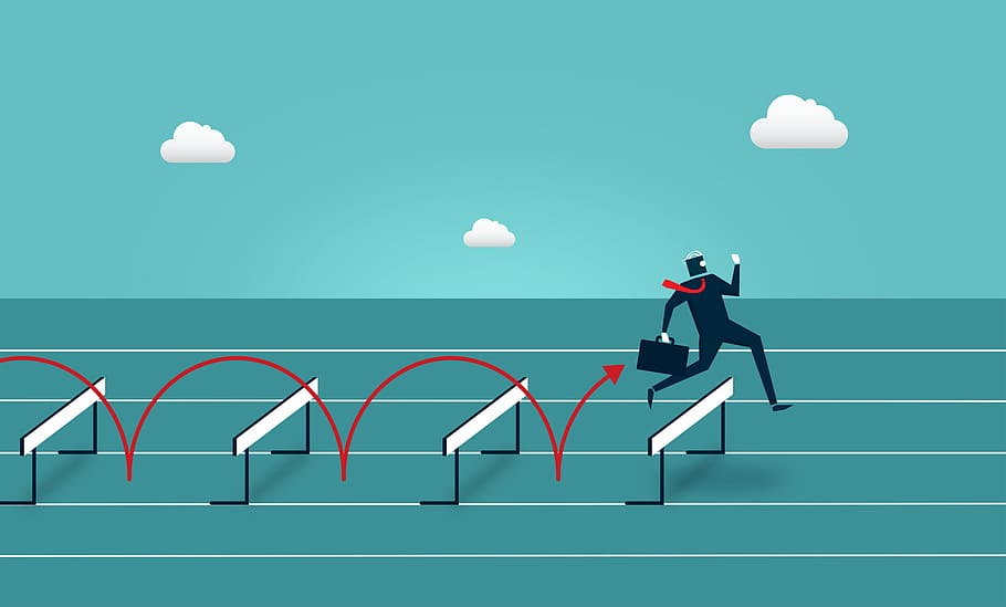 A clip art style graphic. Top half is a blue sky with 3 white clouds. Bottom half is a teal race track with 4 white hurdles. Over each hurdle is a red arrow that leads up to the business man running over the fourth hurdle. He is a dark blue block style figure with white hair and a red tie flapping behind him. In his right hand he holds a briefcase, and in his left he is looking at a phone screen whilst running.