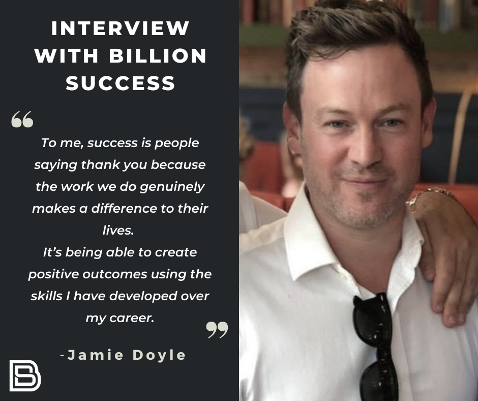 """Image split in half. On the right hand side a headshot of Jamie Doyle smiling in a white shirt. On the left reads: Interview with Billion Success. """"Interview with Billion Success"""" - Jamie Doyle'."""