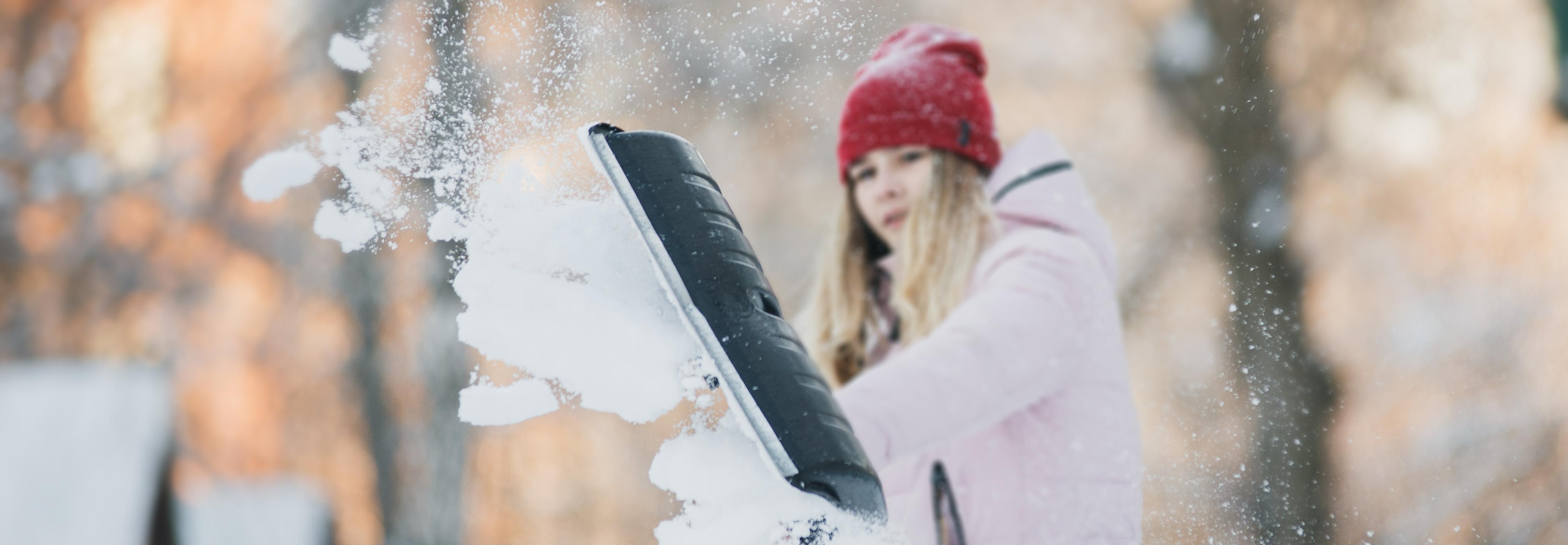 Teen girl shovelling snow