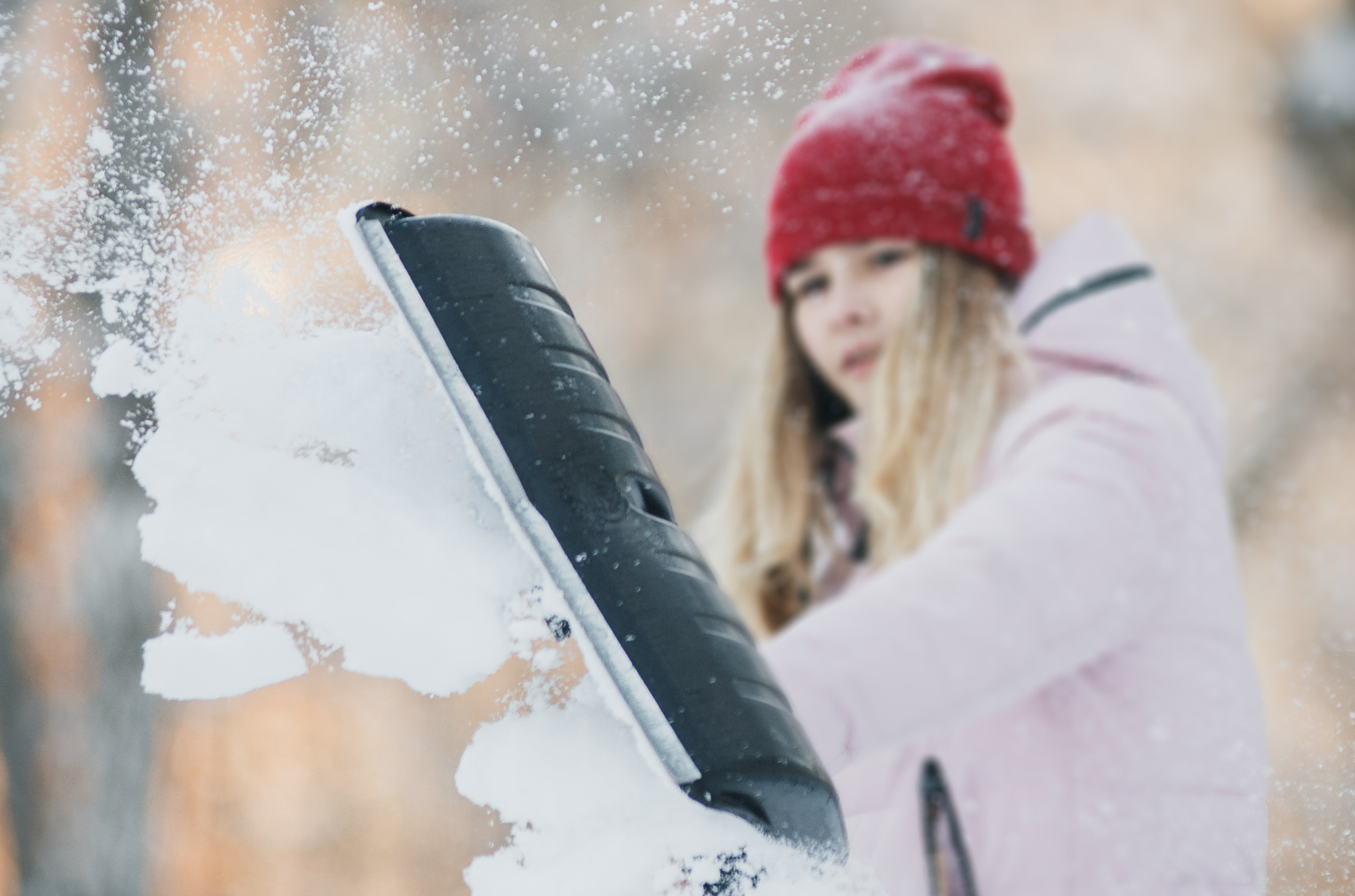 Teen girl shovelling snow