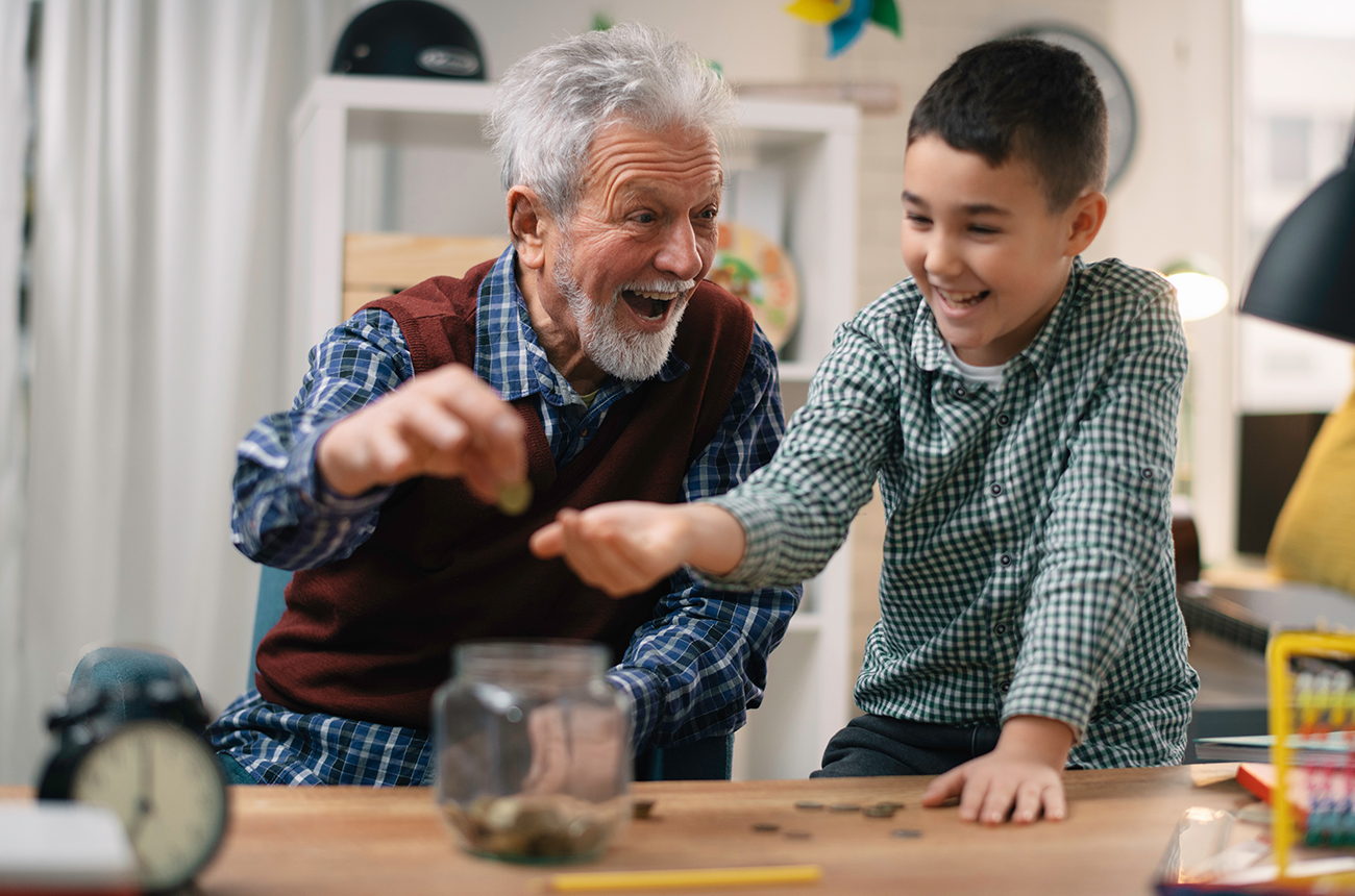 Grandpa teaching grandson about money