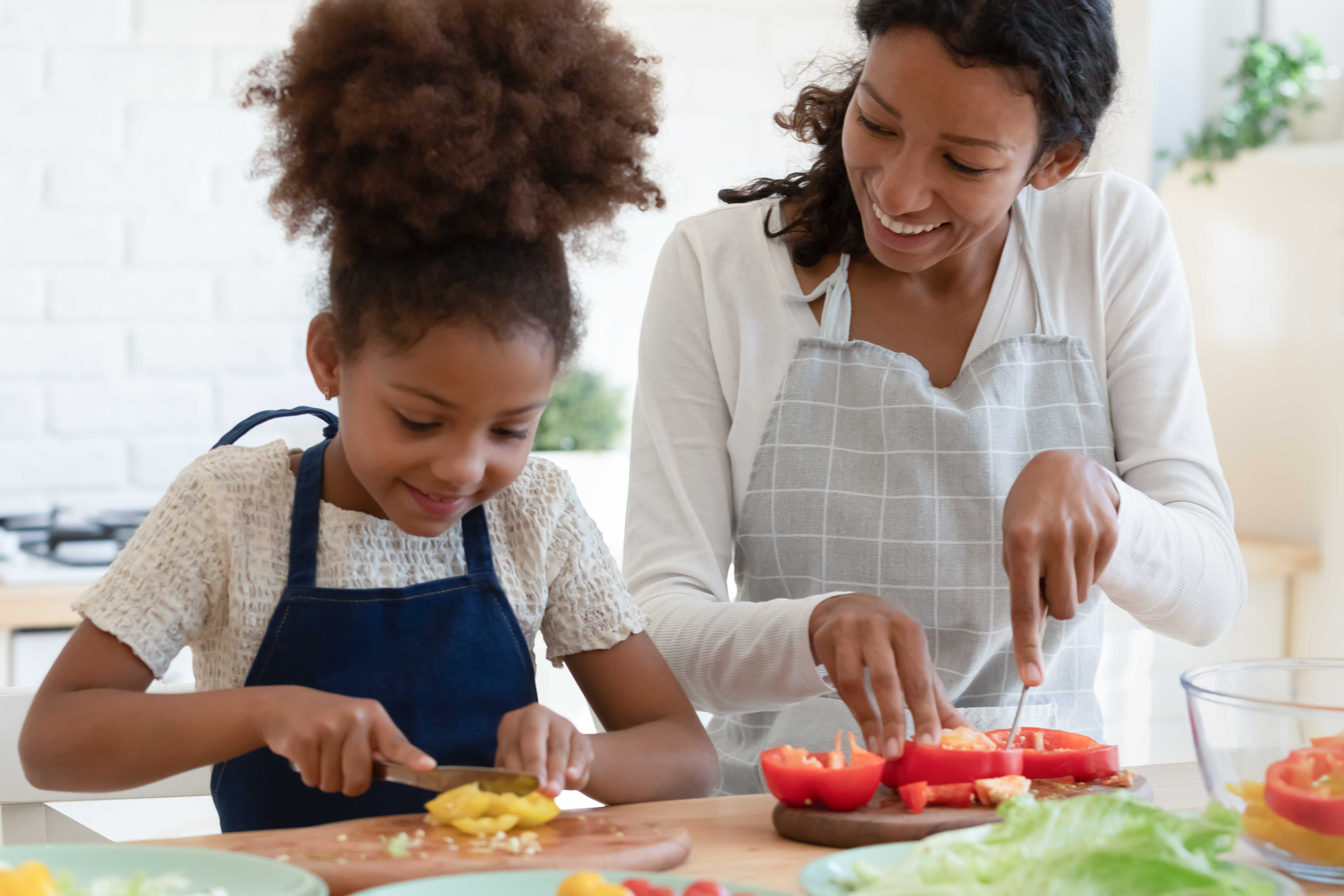 A child helping her mom cook