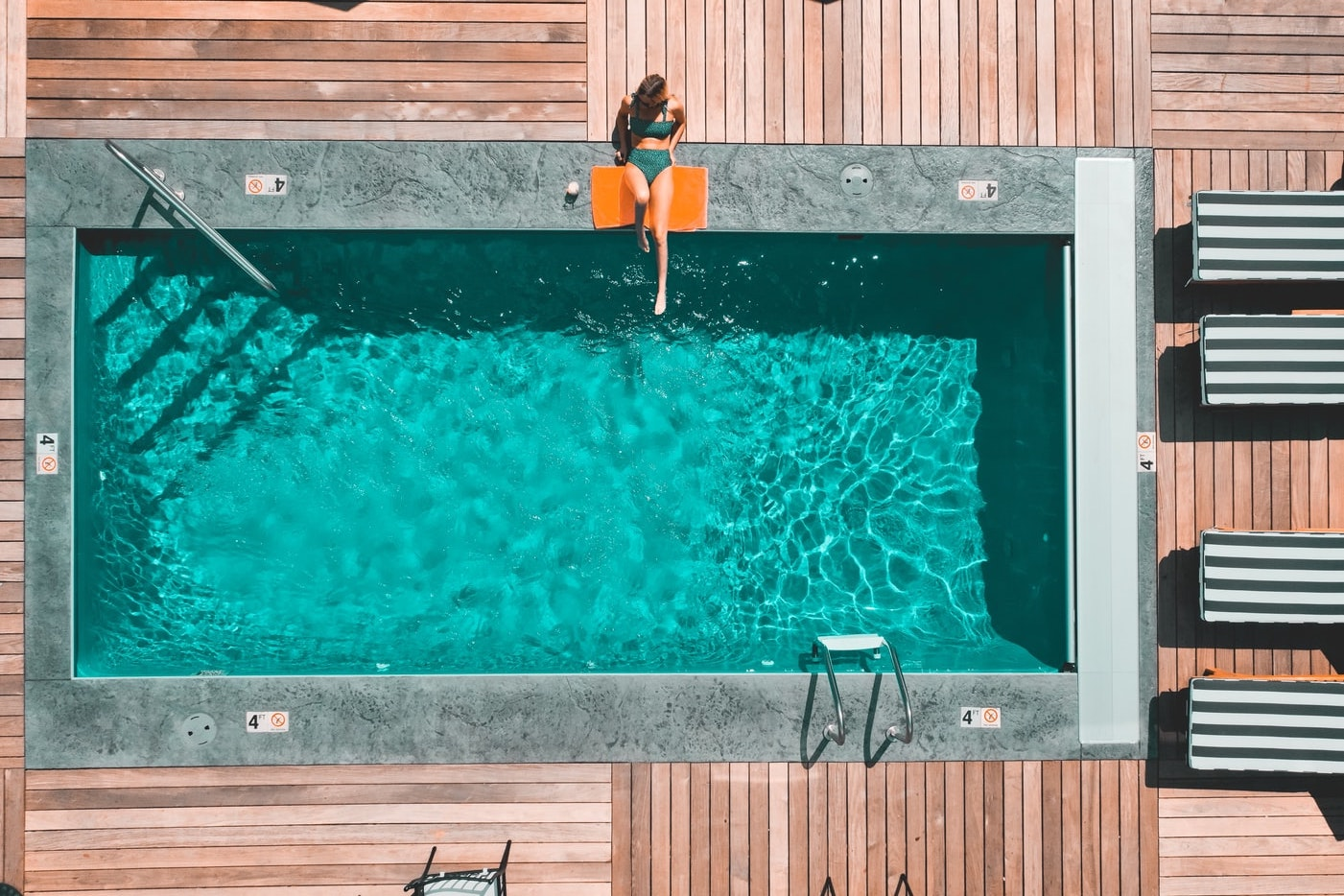 Overhead view of a beautifully maintained, crystal-clear pool