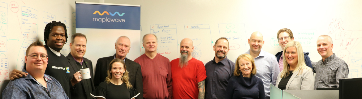 Many staff from Maplewave posing for a picture at Maplewave offices in Dartmouth Nova Scotia