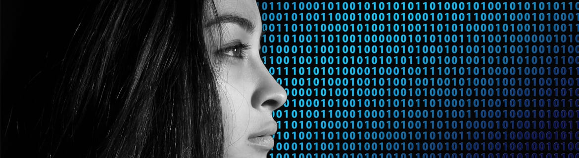 Profile of woman in black and white against an illustrated background of code made of 1's and 0's.