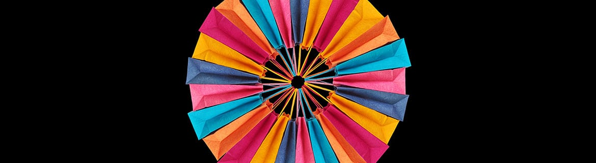 A colourful wheel made from shopping bags
