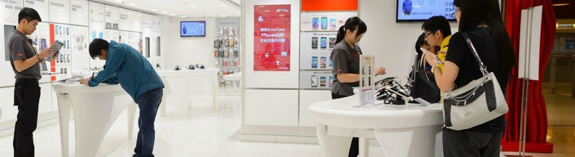 Group of people in an Asian telco retail store