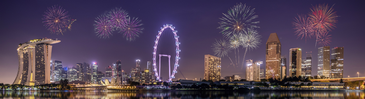 Singapore at night with ferris wheel and fireworks