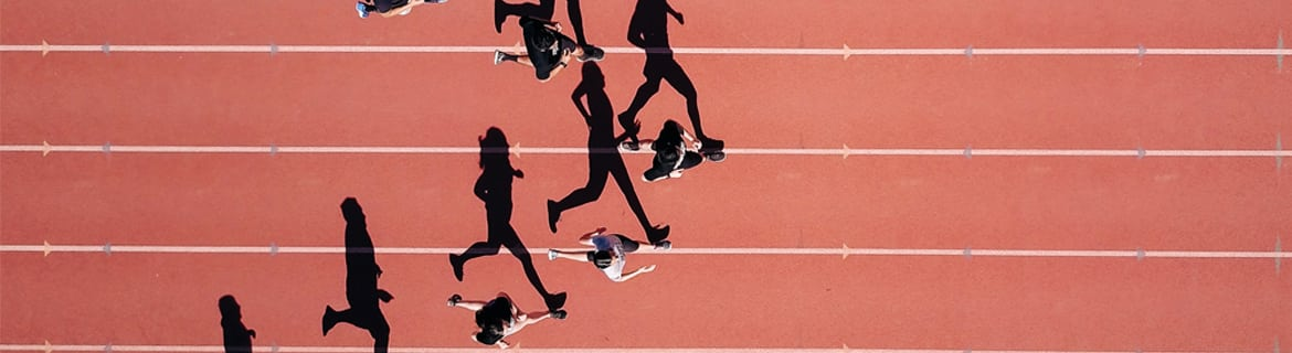 View from above of runners on a racetrack running