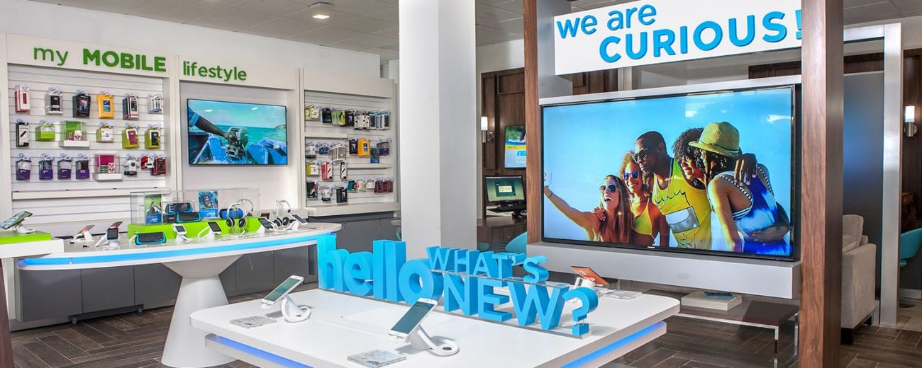 Inside Flow Wireless store featuring product tables with smartphones on display